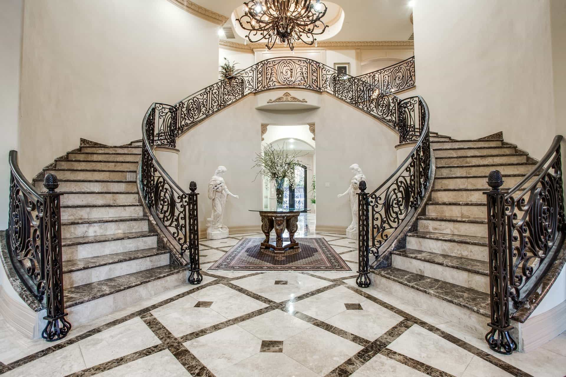 Mediterranean Inspired Living Room With Luxurious Marble Floors And A Double Staircase With Stunning Chandelier (Photo 11 of 13)