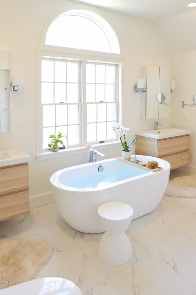 Mid Sized Cozy Trendy Master Bathroom Remodel With Light Wood Cabinets And Freestanding Tub (Image 7 of 14)