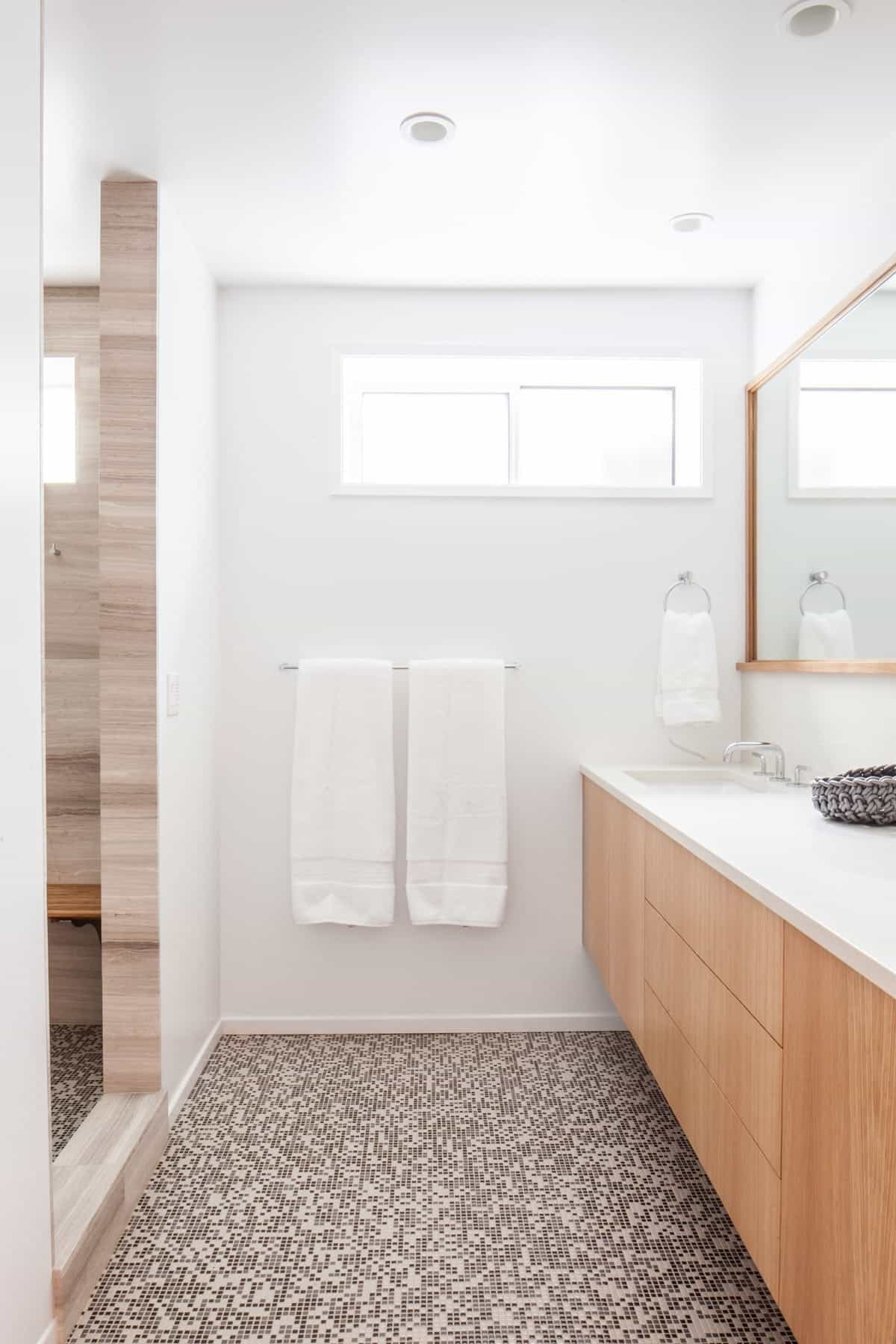 Modern White Bathroom Features Brown Mosaic Tile Floors (View 11 of 20)