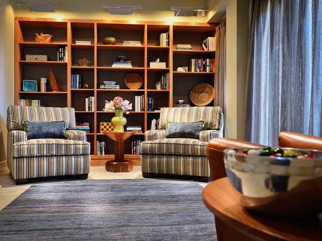 Neutral Living Space With Blue Accents And Wood Bookcase (Image 20 of 29)