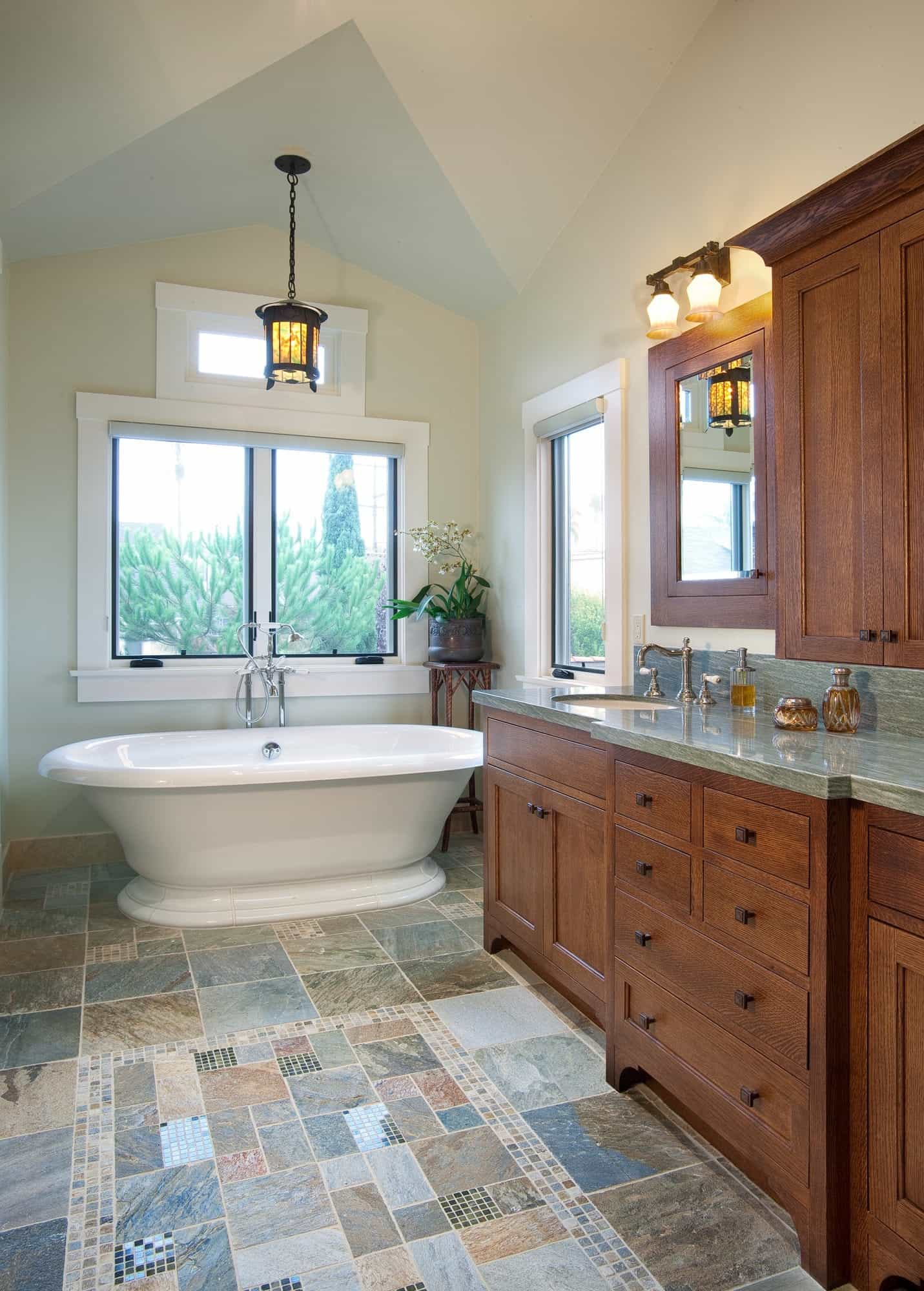 Patchwork Tile Flooring And White Bathtub In Craftsman Bathroom With Built In Wood Cabinets (Image 15 of 20)