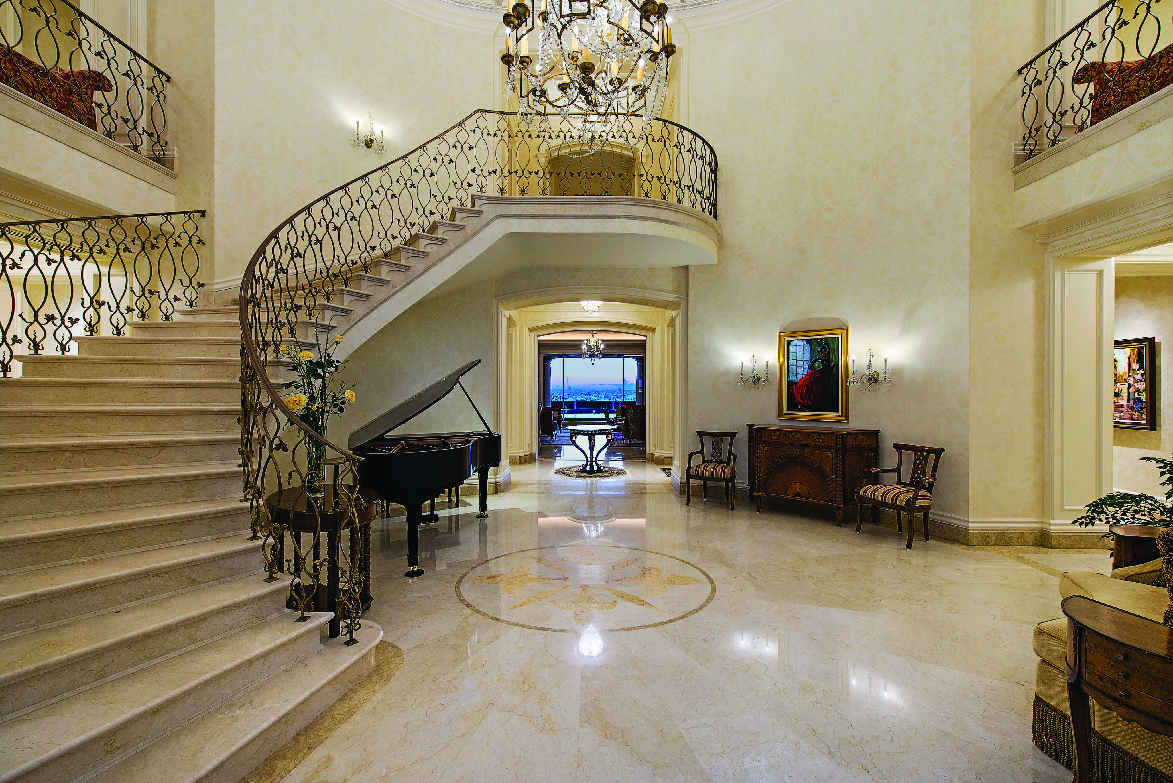 Pristine Marble Floors And An Elegantly Curved Staircase (Image 8 of 13)
