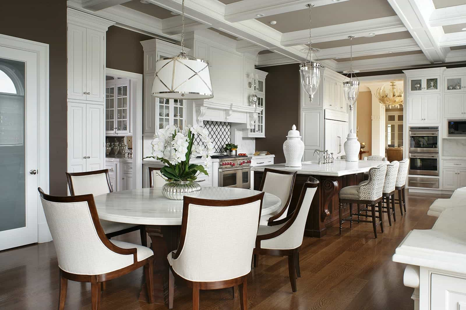 Sophisticated Italian Kitchen And Dining Room Combo With Marble Topped Dining Table (View 8 of 25)