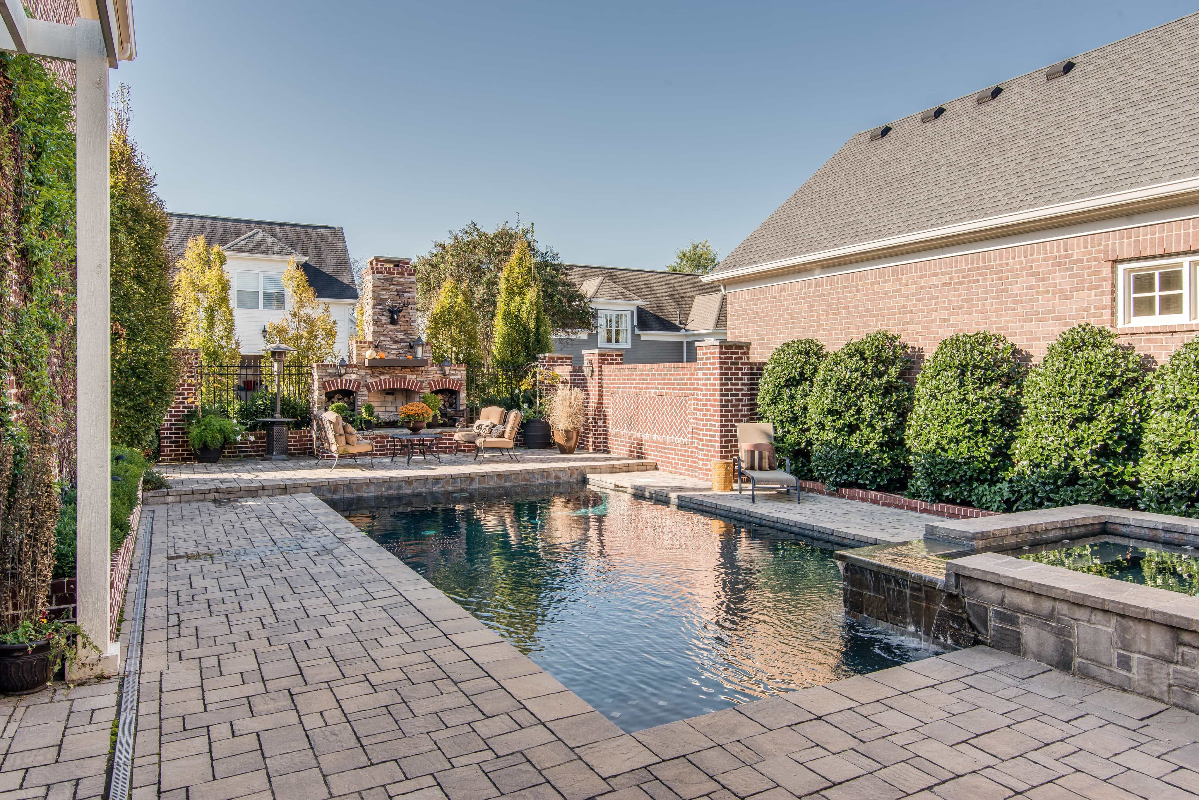Stone And Brick Outdoor Patio With Swimming Pool (View 9 of 25)