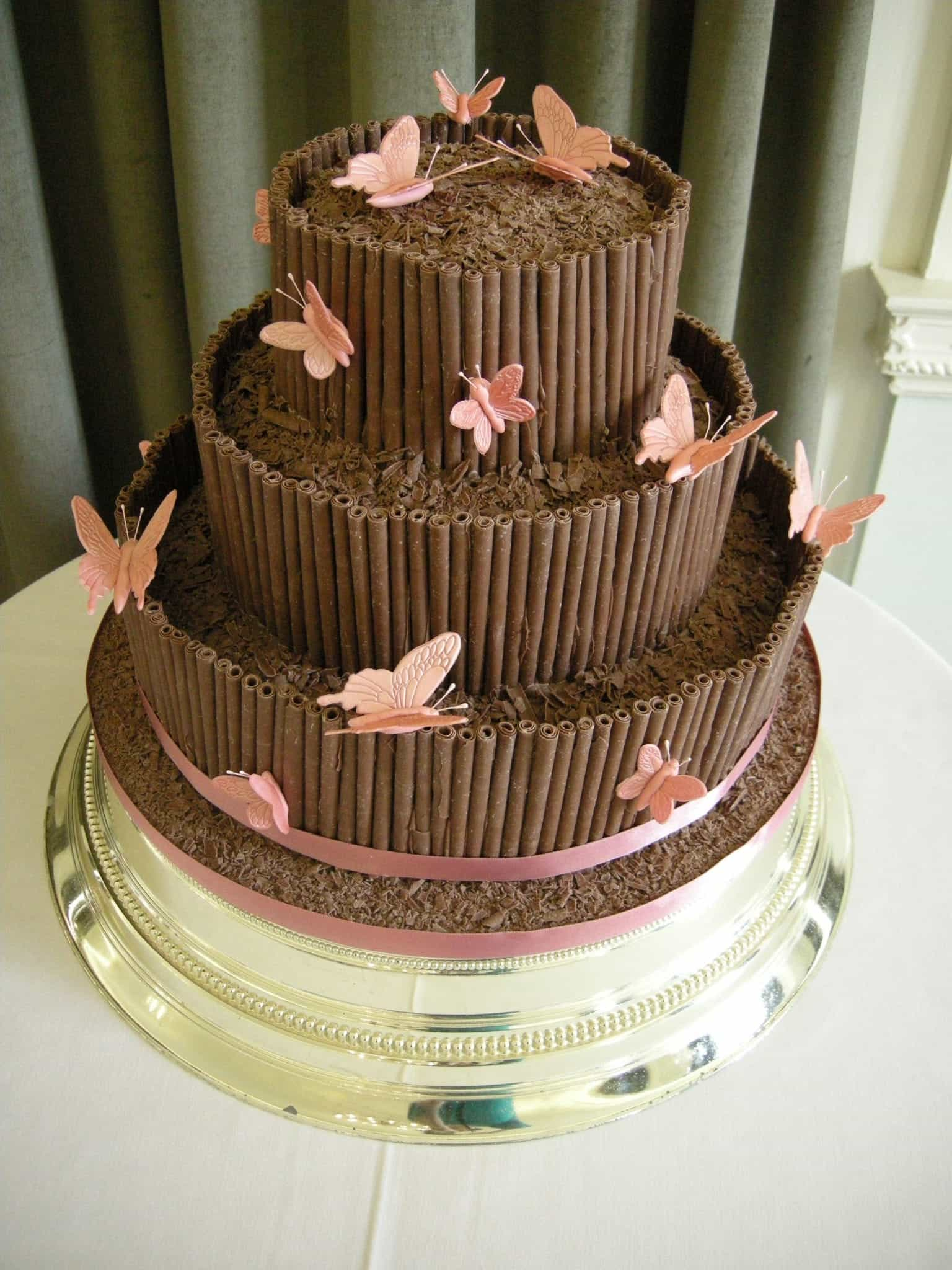 Wedding Cakes Coated With Milk Chocolate And Has Milk Chocolate Cigarellos And Butterflies (View 2 of 30)