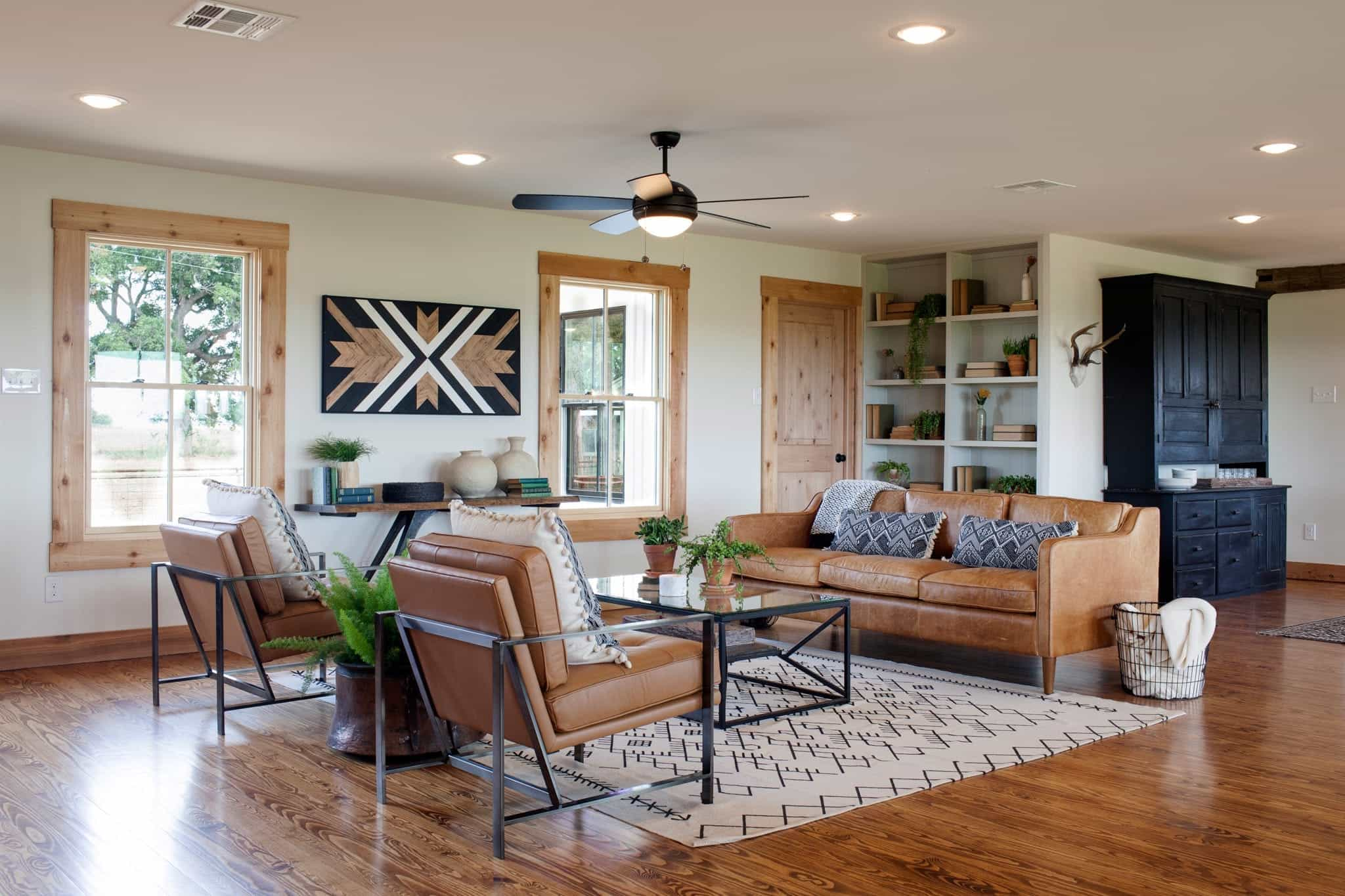 Wood Floors And Graphic Carpet Add Brightness To Living Room (Image 12 of 13)