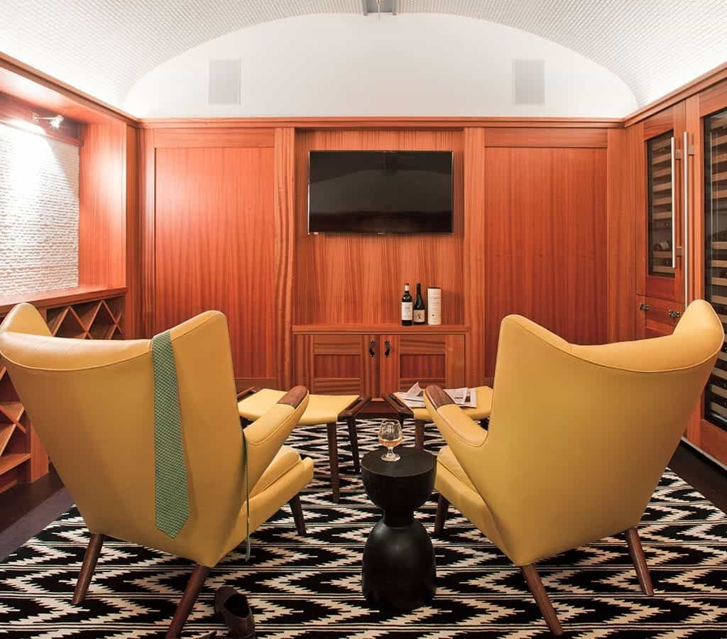 Wood Paneled Home Theater With Yellow Armchairs (View 16 of 21)