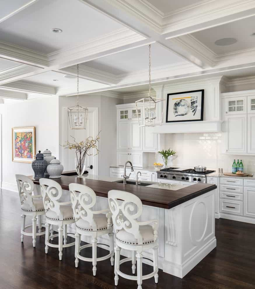 Classic Inspiration For A Timeless Kitchen Remodel With Raised Panel Cabinets, Dark Hardwood Floors, An Island And Marble Countertops (View 12 of 15)