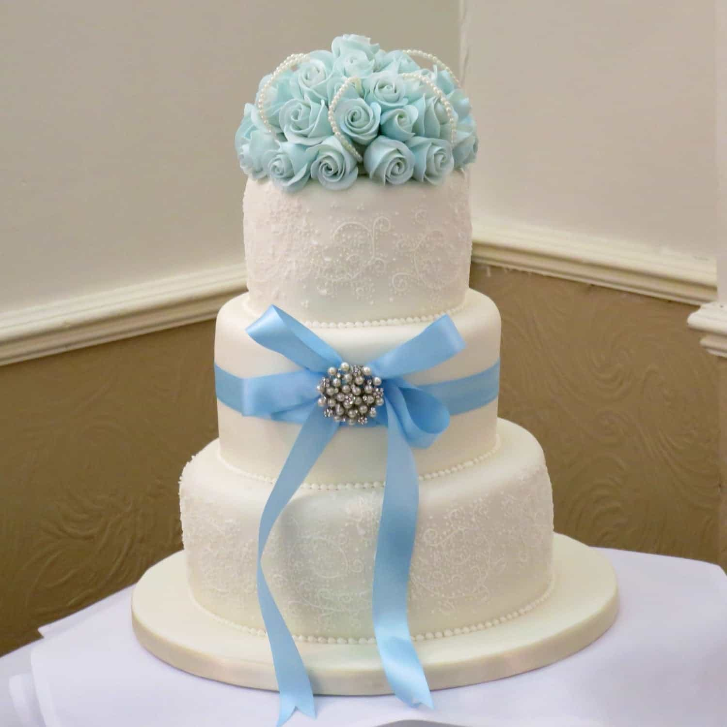 Classic Wedding Cake With Pretty Blue Shaded Roses With Icing Embroidery (Image 10 of 16)