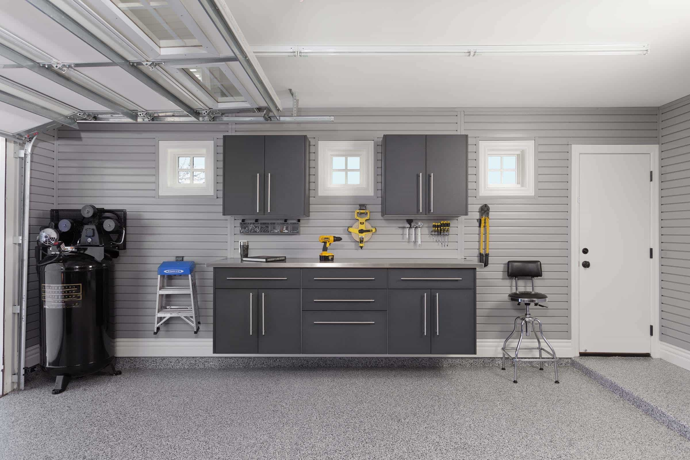 Contemporary Garage Interior With Modern Cabinet Storages And Shelves (View 3 of 10)