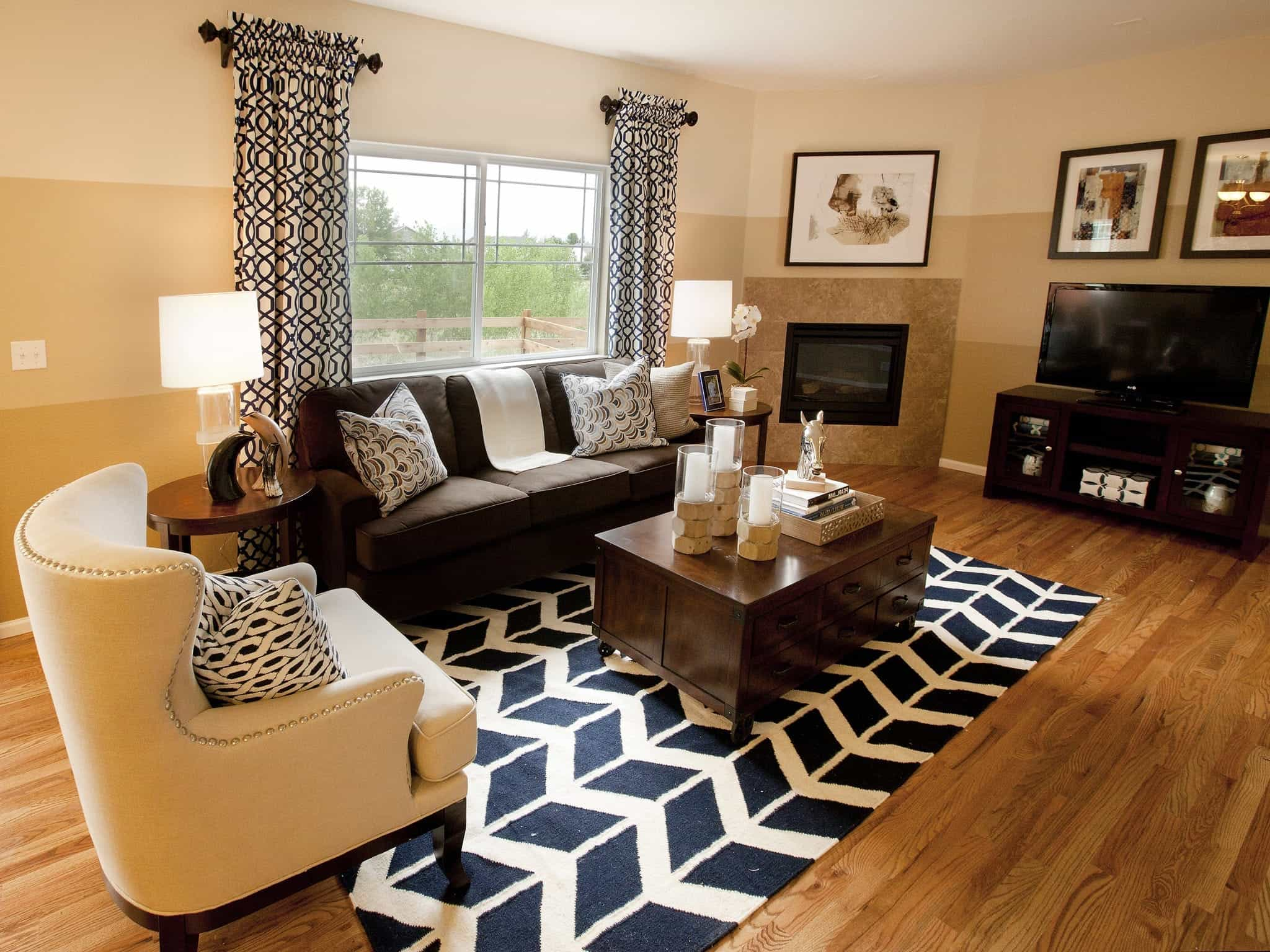 Contemporary Living Room Features A Corner Fireplace And Graphic Print Drapes And Rug (View 3 of 13)