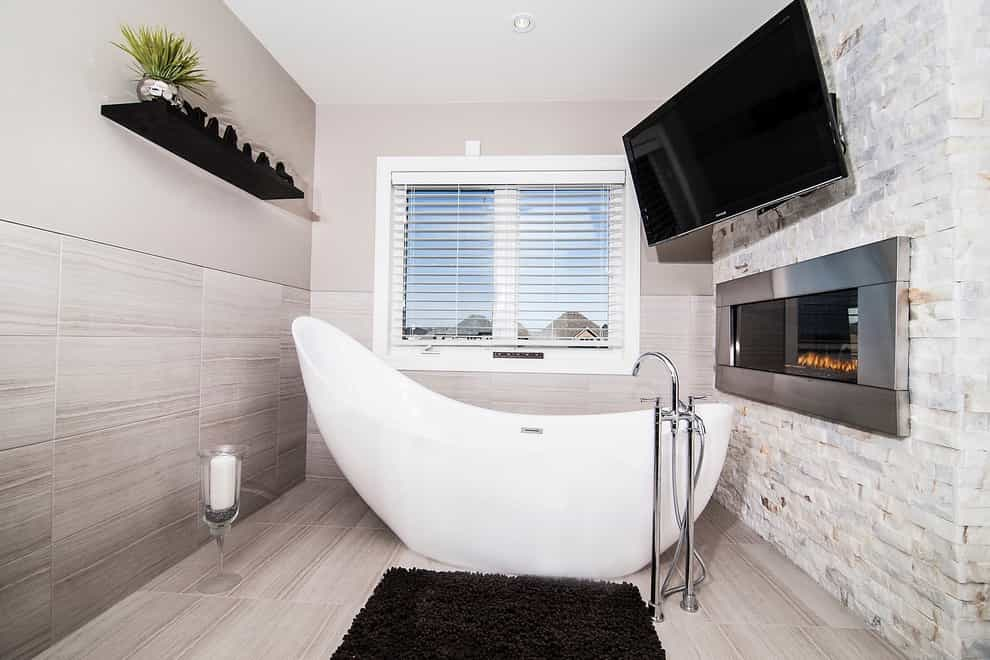 Contemporary Luxury Bathroom With Fireplace And Wall Mounted Large TV (Image 6 of 15)