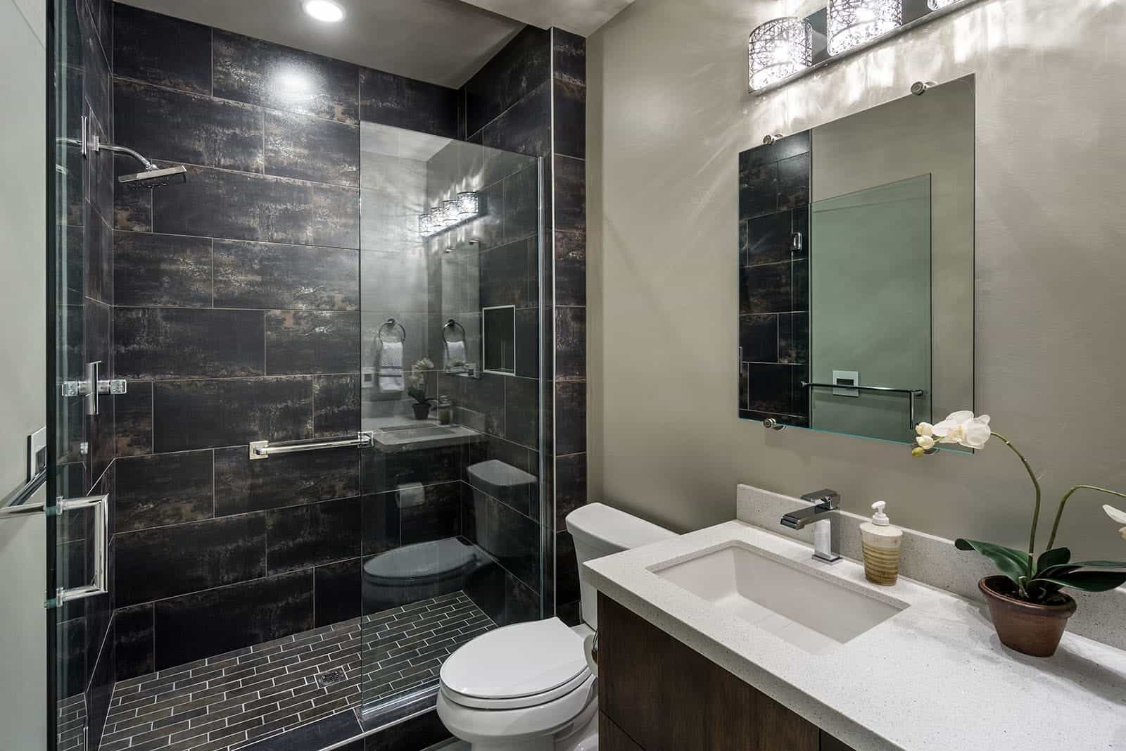 Dark Marble Wall And Light Countertop Creates Sharp Contrast In Contemporary Bathroom (View 9 of 10)