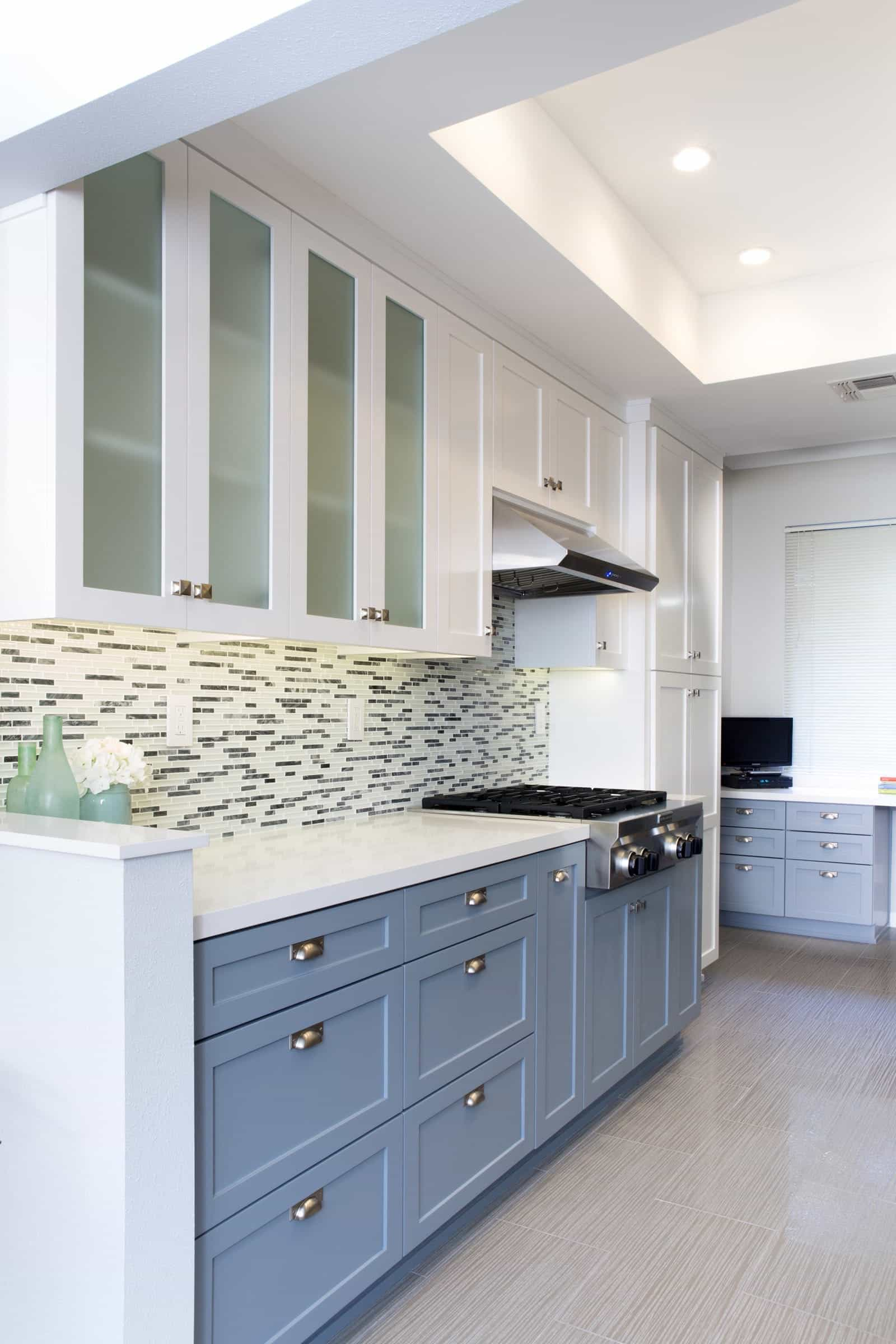 Gray And White Kitchen Features Two Colors Flat Cabinets And A Striking Glass Tile Backsplash (View 6 of 10)