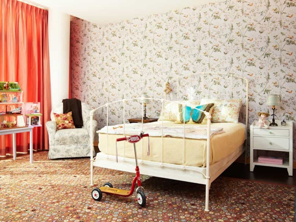 Kids Bedroom Features An Eclectic Mix Of Floral Patterns And Bright Orange Curtains (Image 19 of 27)