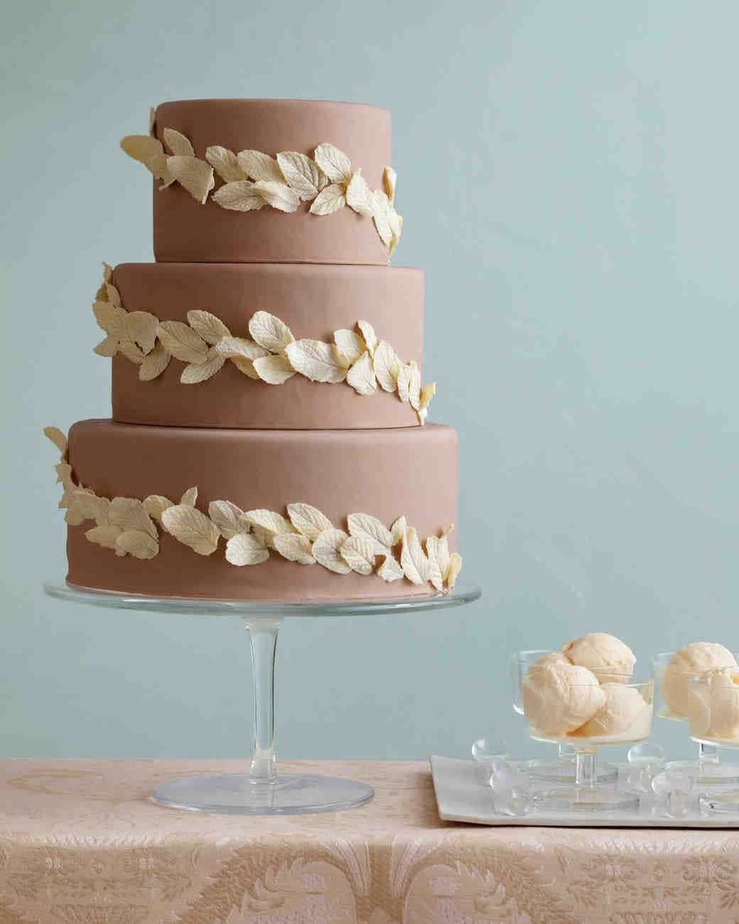 Long Chocolate Wedding Cake With White Leaf Decoration (View 21 of 30)