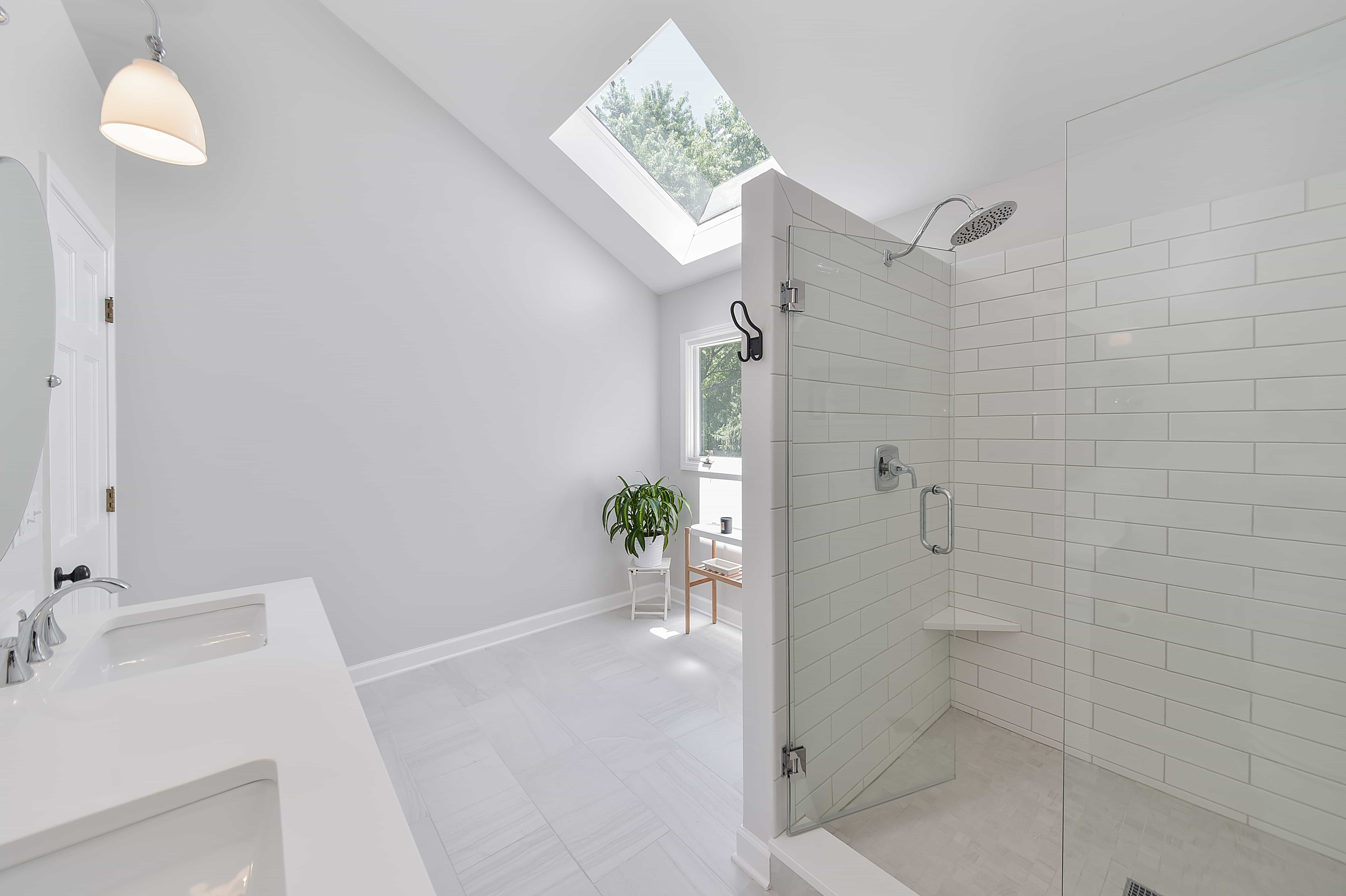 Monochromatic Contemporary Bathroom And Shower Combo With Glass Door Walk In Subway Tile Shower And Skylight (View 1 of 16)