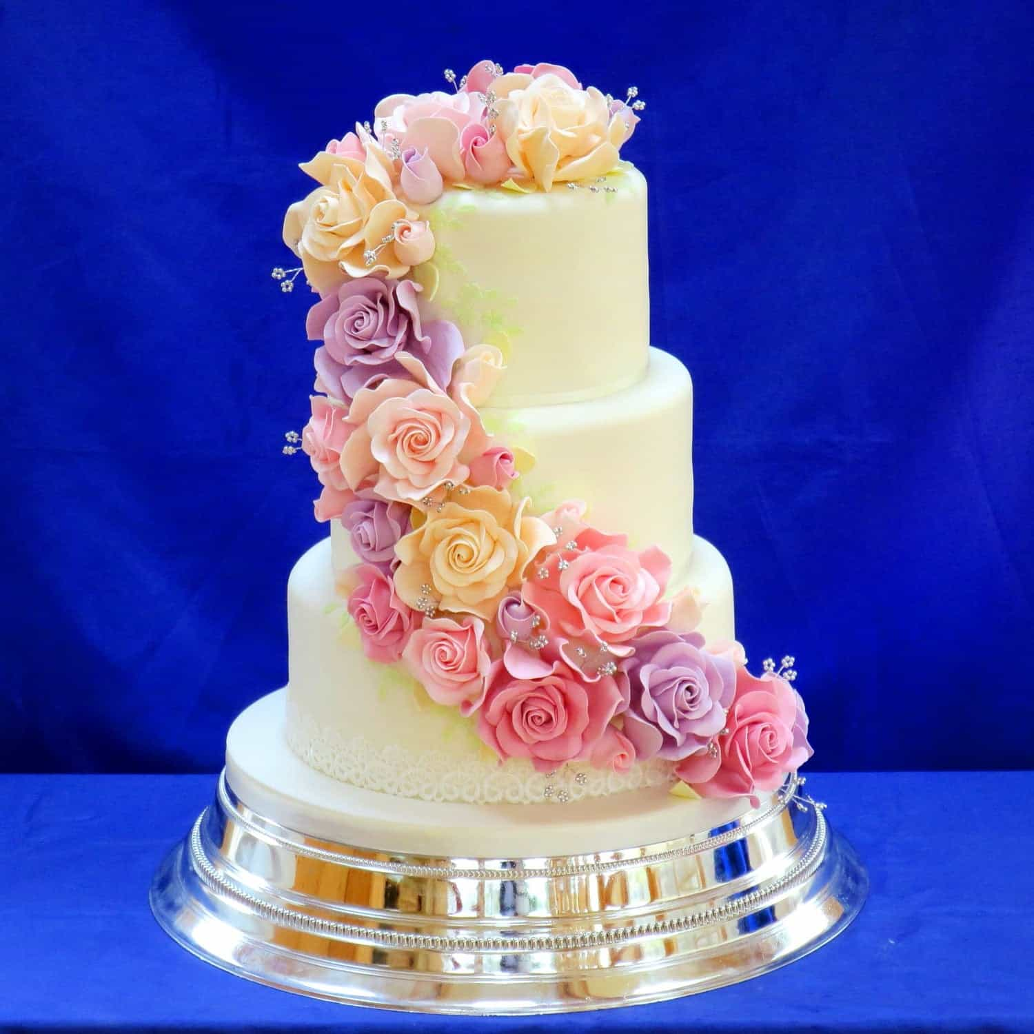 Romantic Classic Wedding Cake Decorated With Hand Made Sugar Roses (Image 14 of 16)