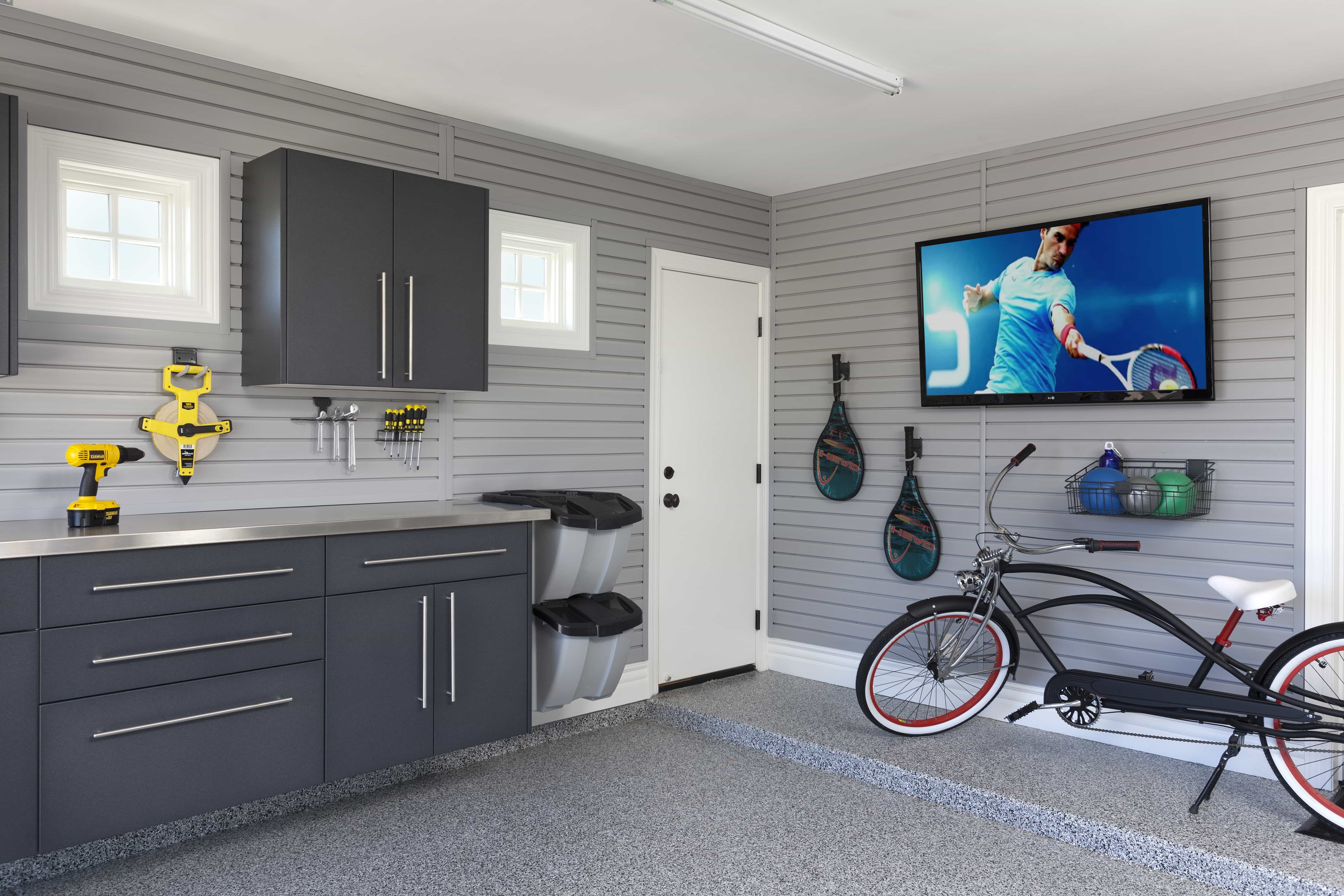 Simple Garage Interior With Flat Cabinets And TV (Image 9 of 10)