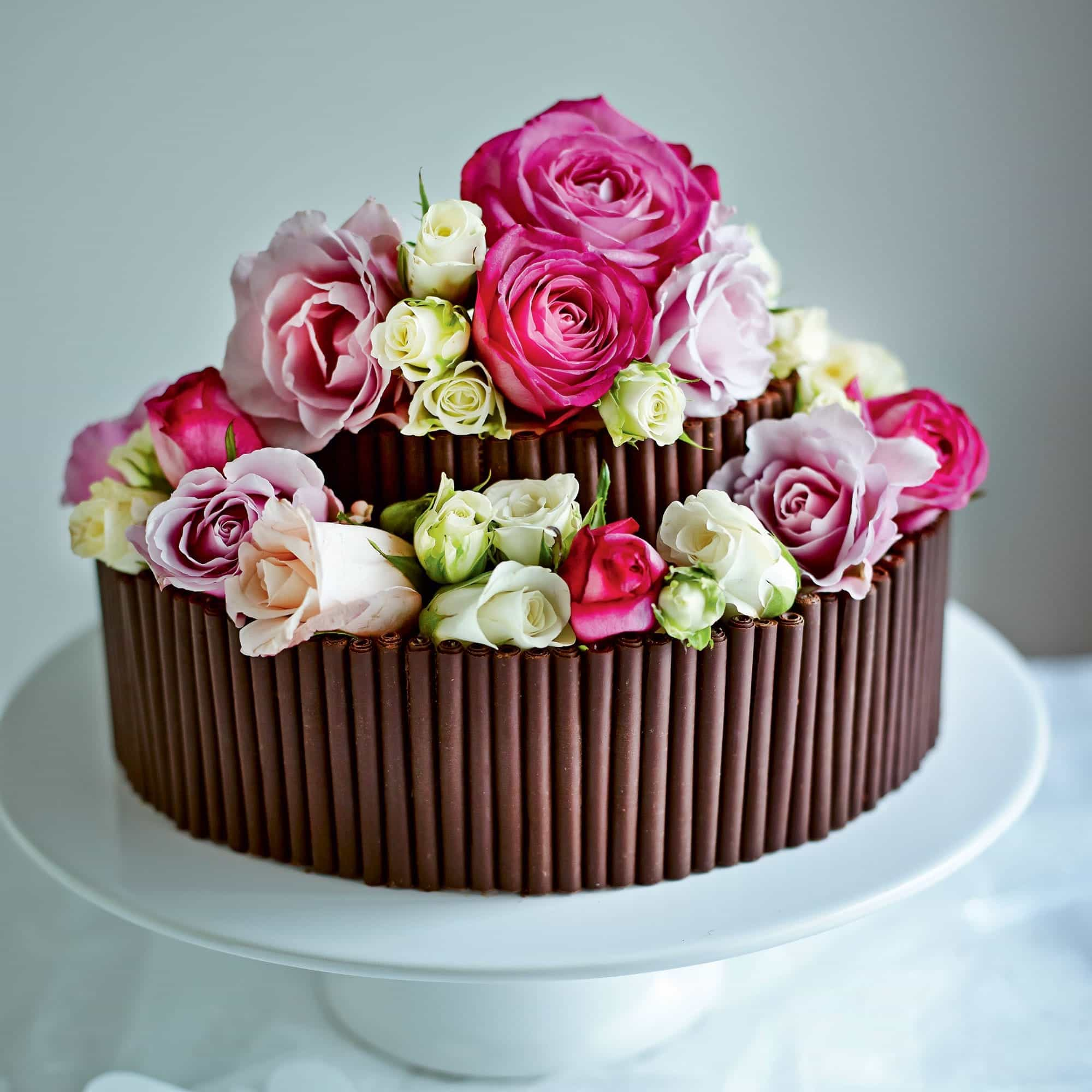 Small Chocolate Wedding Cake With Roses Top (View 10 of 30)