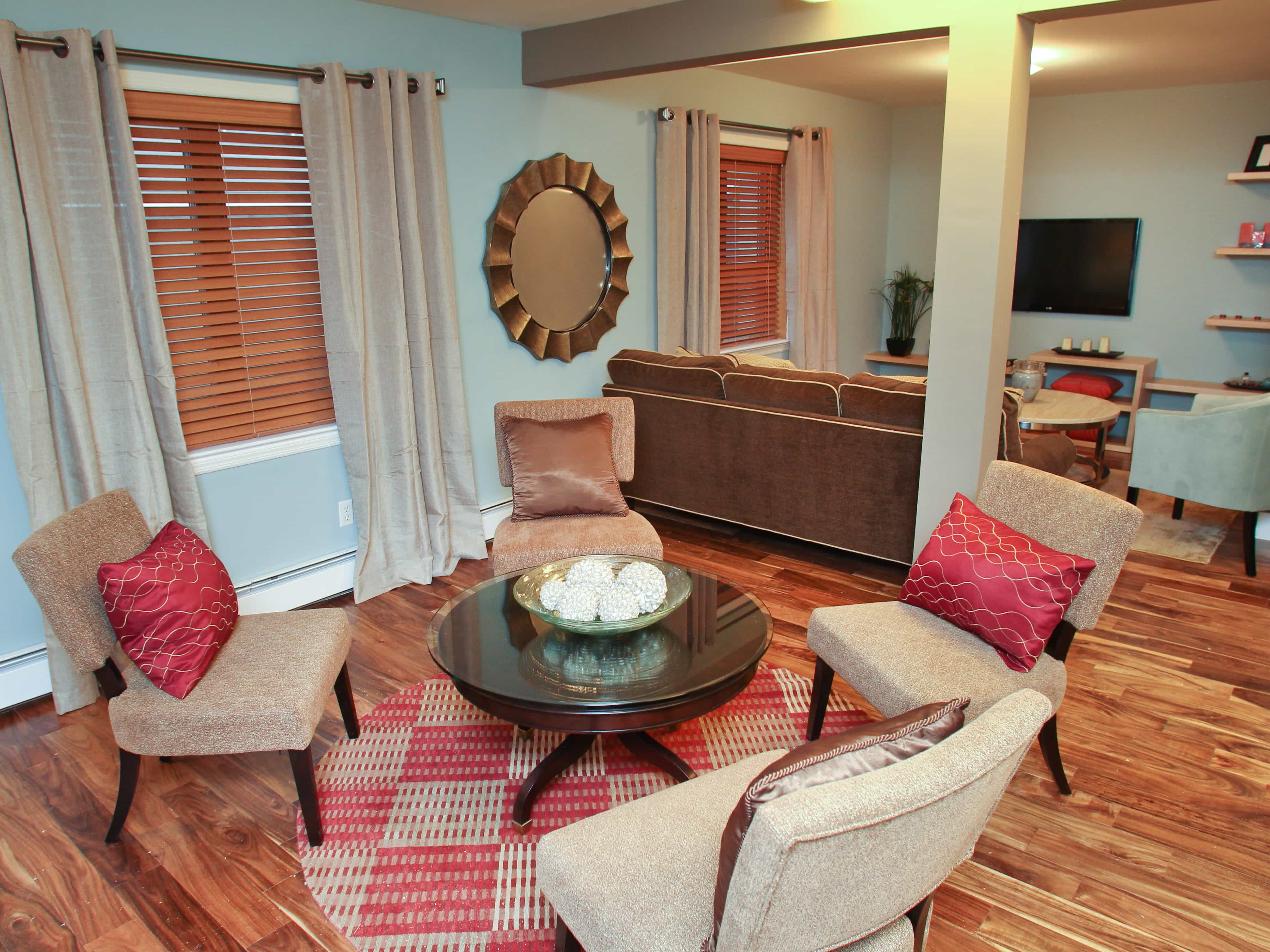 Traditional Living Room With Round Red Checkered Area Rug (Image 27 of 28)