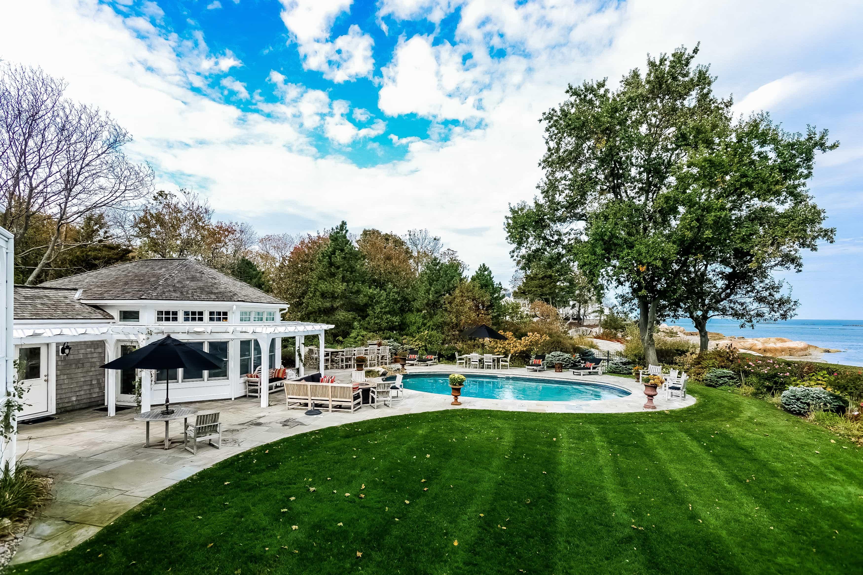 Featured Image of Backyard Features Stone Patio And Private Pool
