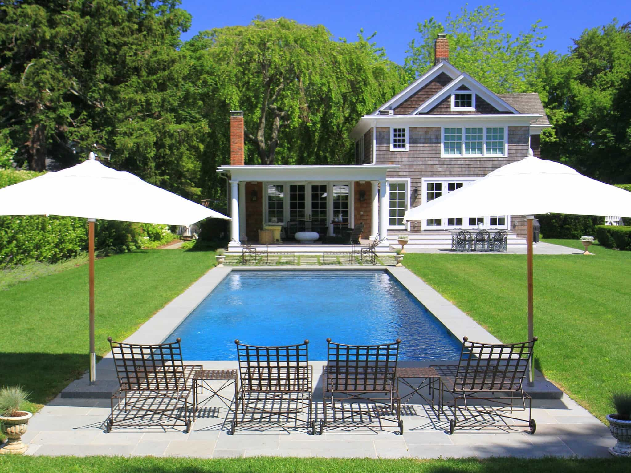 Featured Image of Backyard Space With Traditional Pool And Outdoor Seating