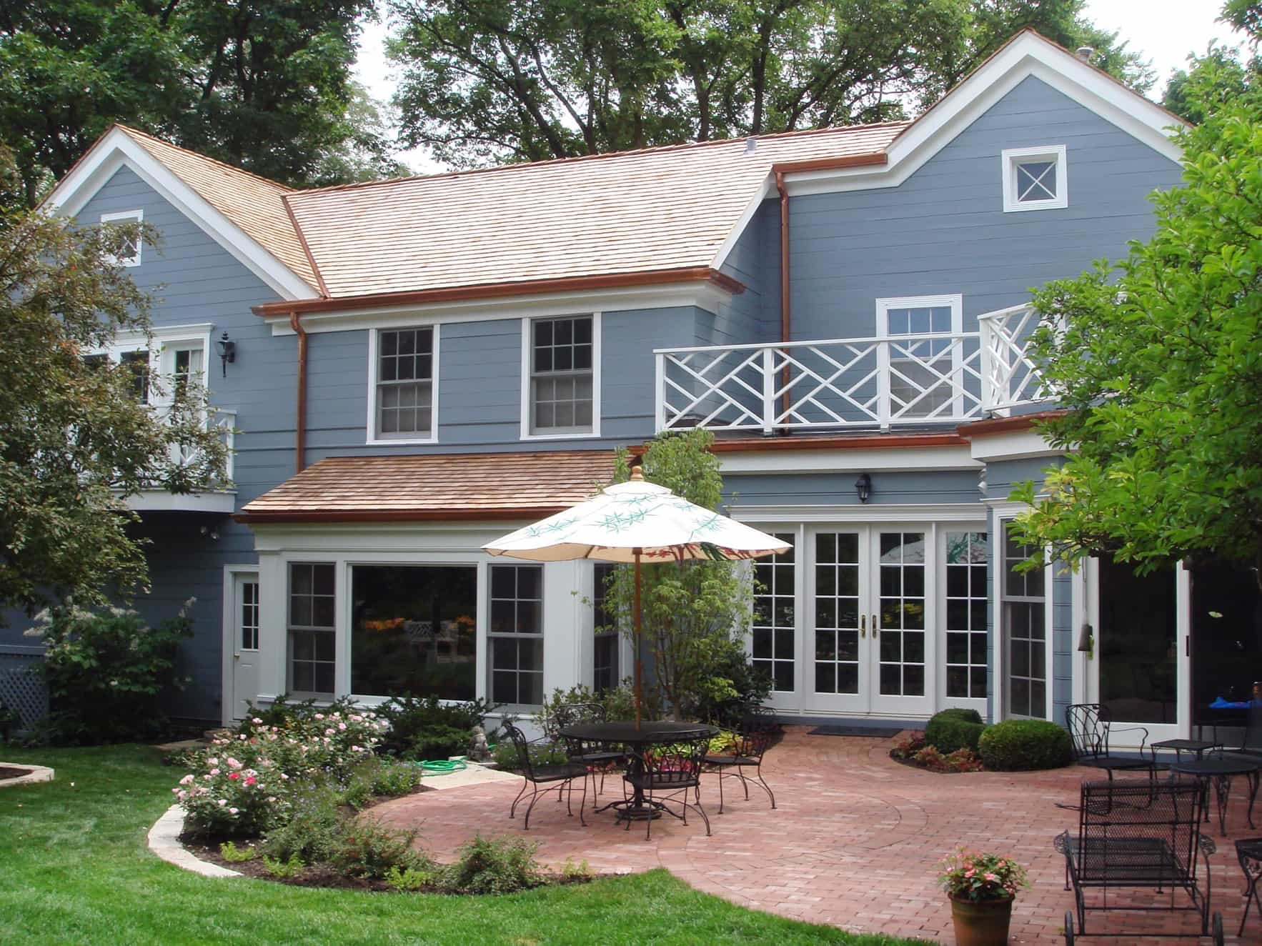 Featured Image of Blue Spanish Home With Small Brick Patio