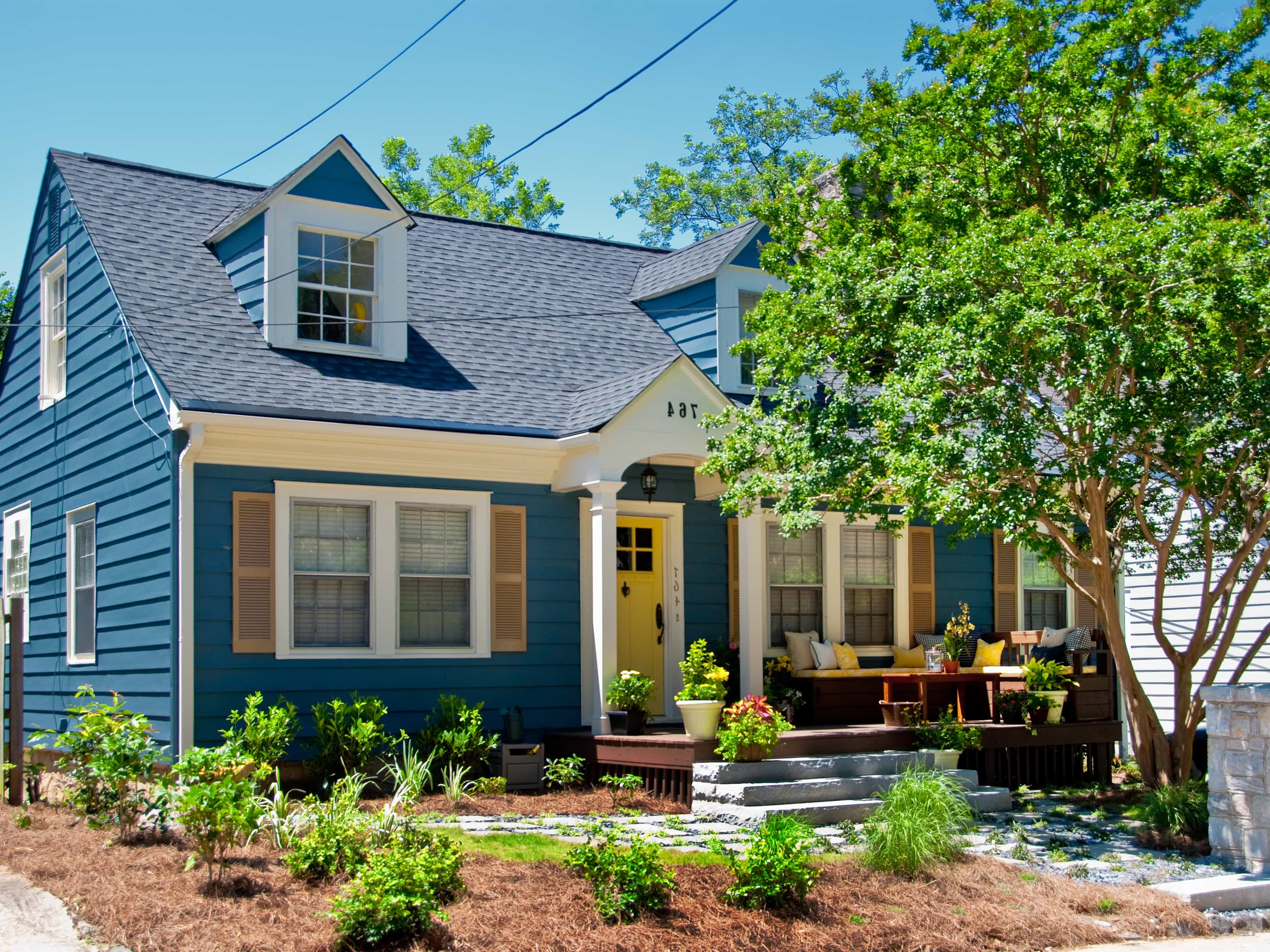 Featured Image of Bright Blue Cape Cod Home Has Curb Appeal