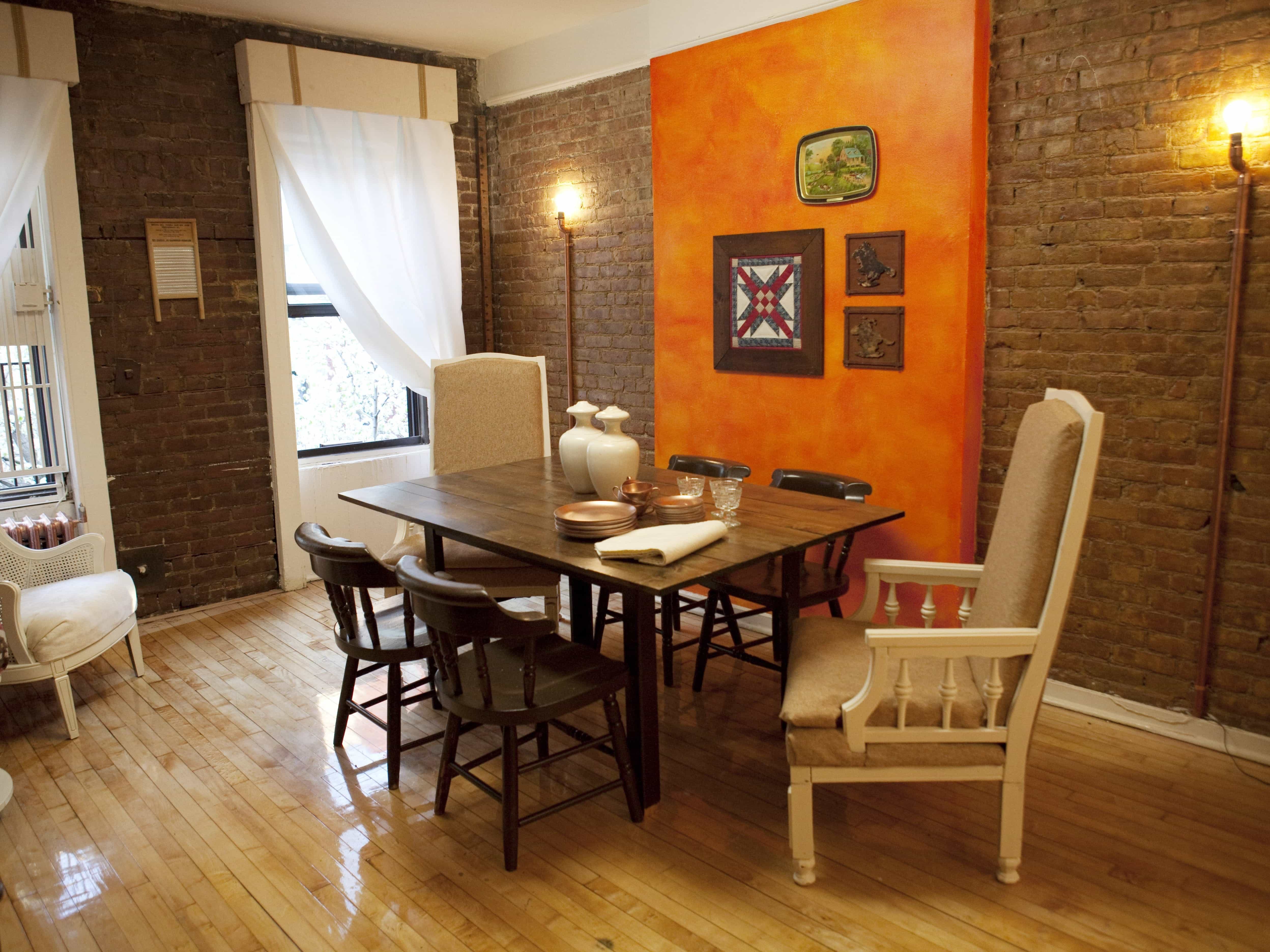 Contemporary Brick Dining Room With Orange Accent Wall (Image 4 of 30)