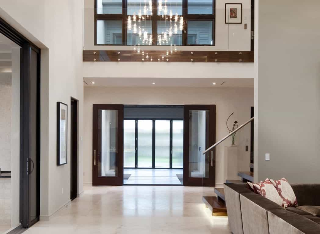 Featured Image of Contemporary Foyer With Rich Brown Accents Sliding Door