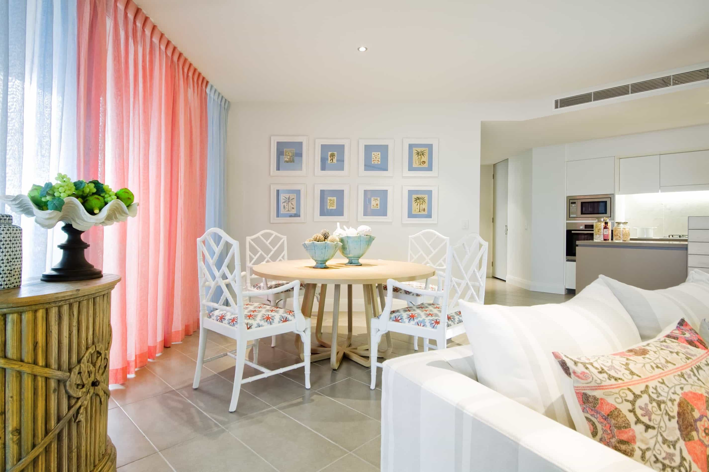 Featured Image of Coral And Dusty Blue Dining Room With Bamboo Chairs
