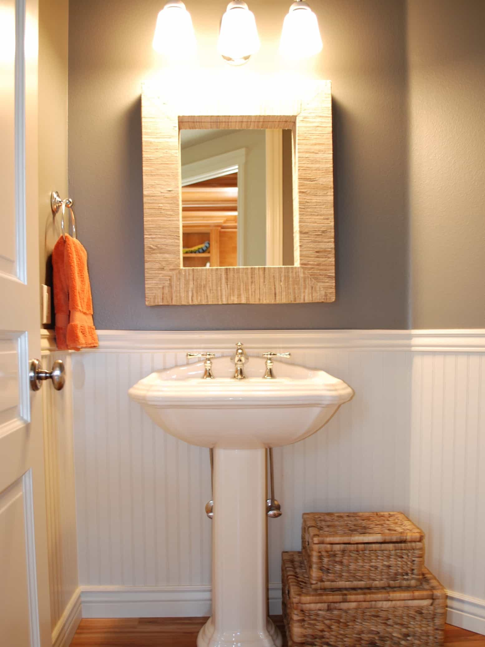 Featured Image of Cottage Powder Room With White Wainscoting And Storage Baskets