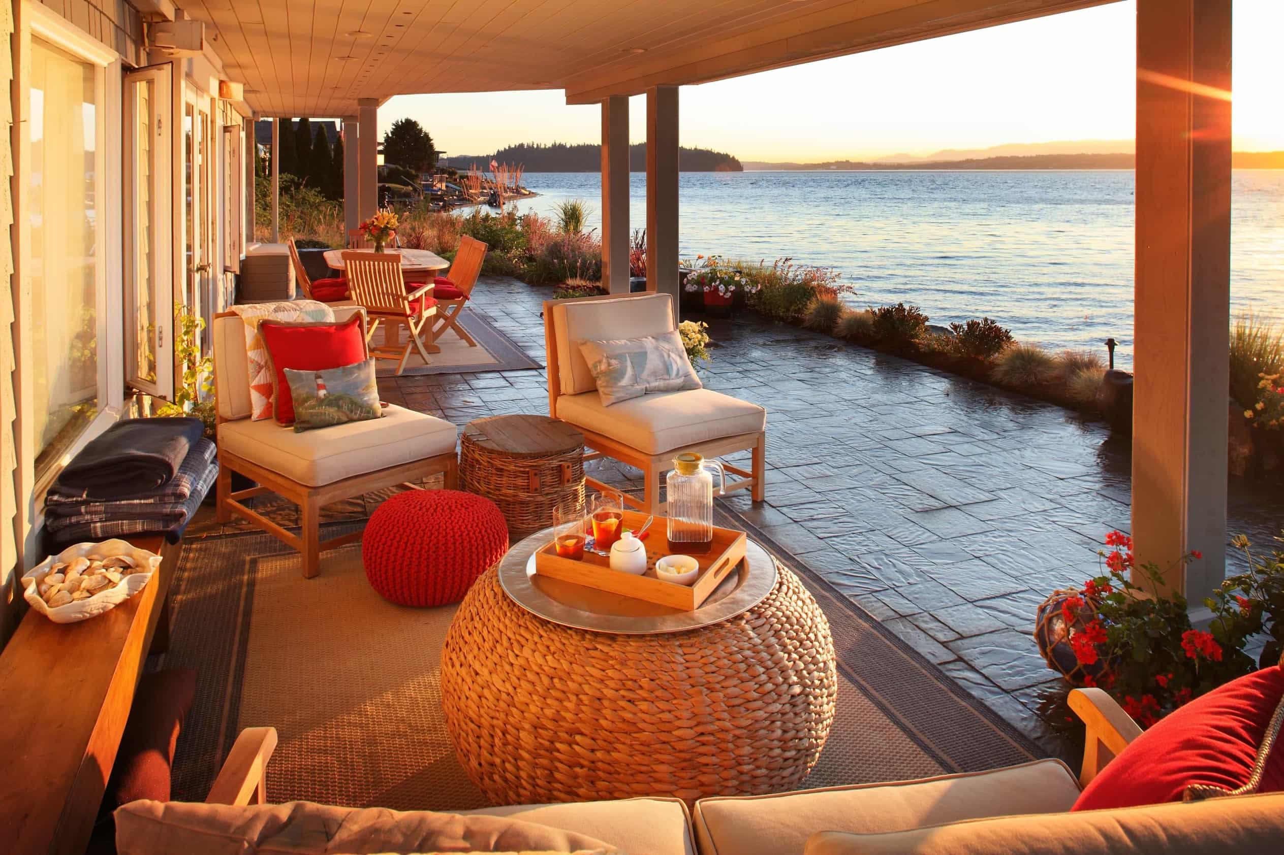 Featured Image of Covered Waterfront Patio With Stone Floor And Woven Ottoman