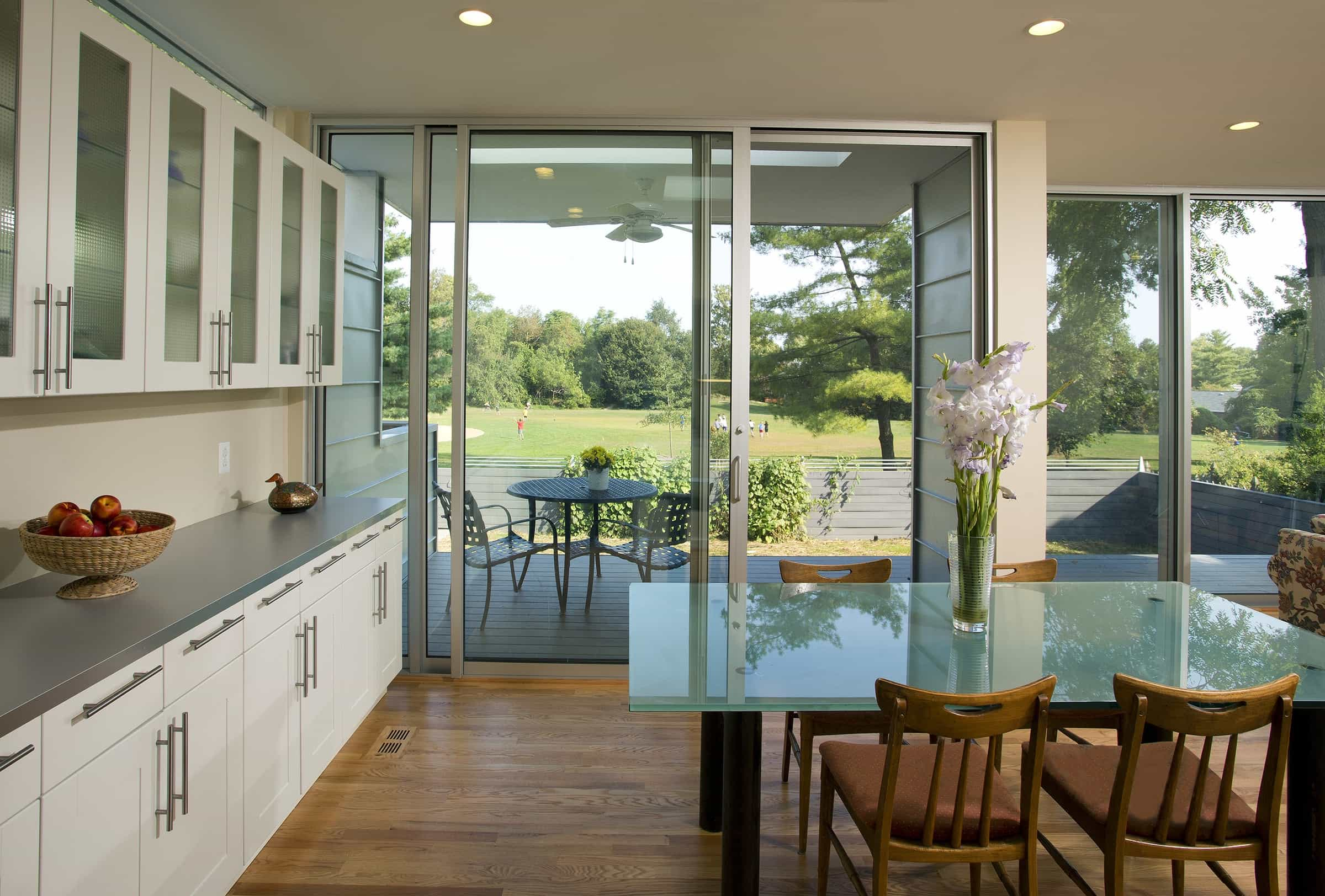 Featured Image of Cozy Cape Cod Dining Area With Sliding Doors