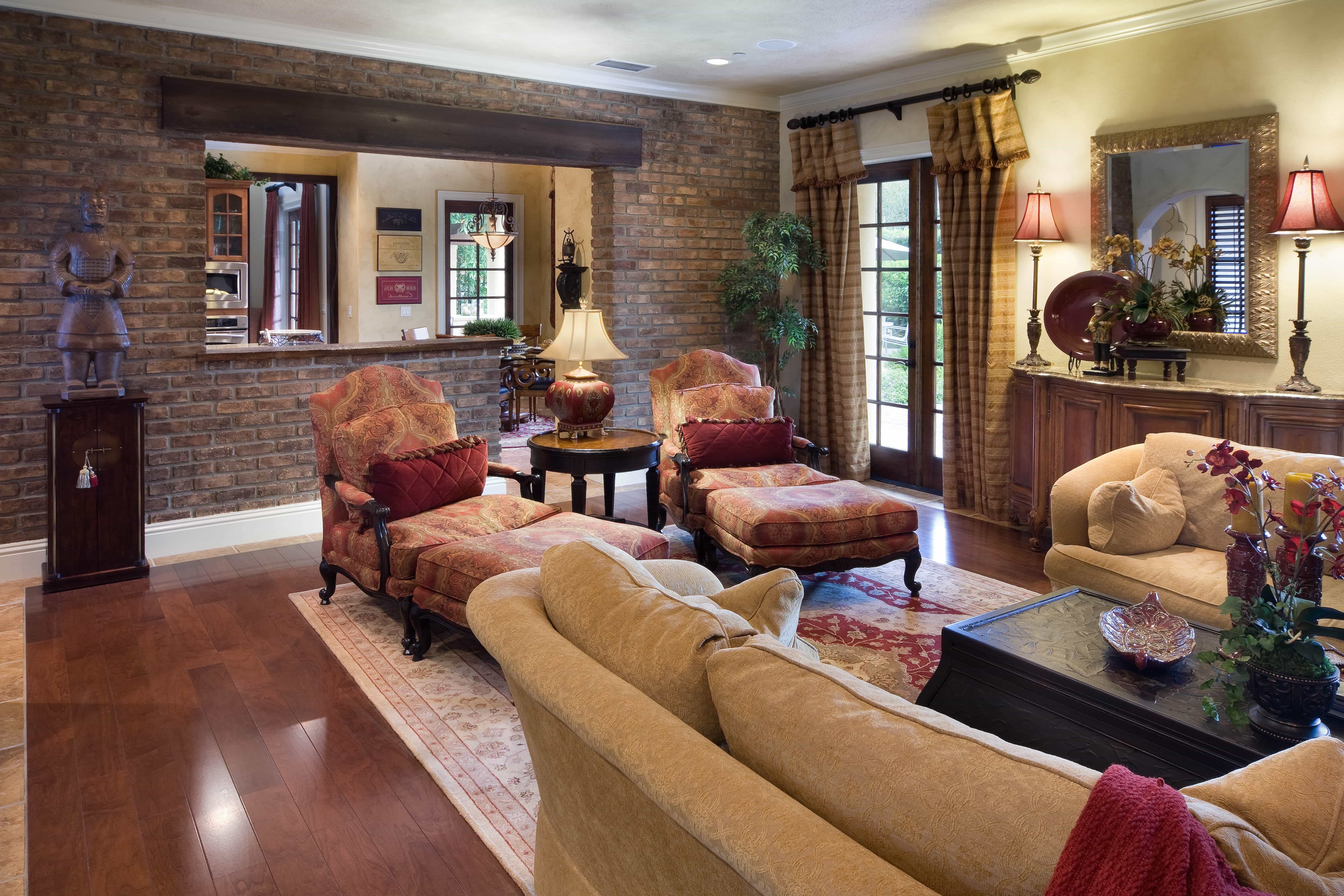 Cozy Tuscan Living Room With Brick Accent Wall (Image 9 of 30)