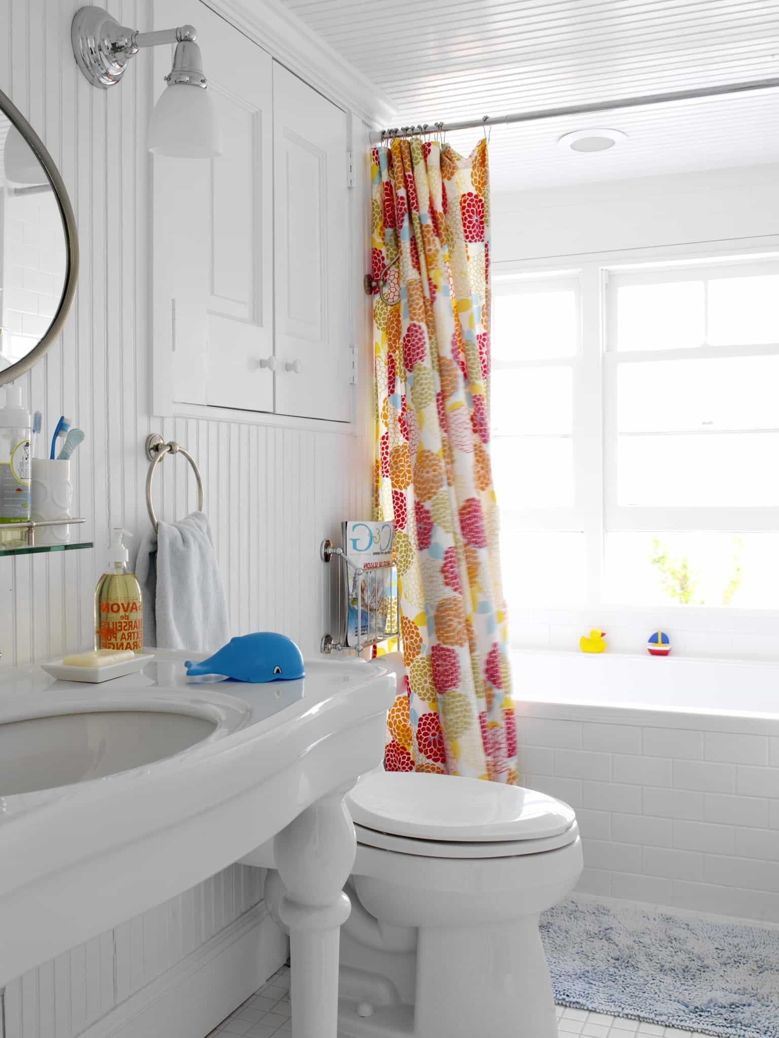 Crisp White Bathroom With Colorful Shower Curtain (View 9 of 14)