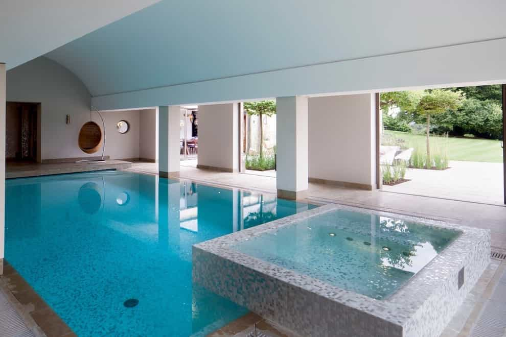 Example Of A Classic Rectangular Indoor Pool Design (Image 3 of 14)