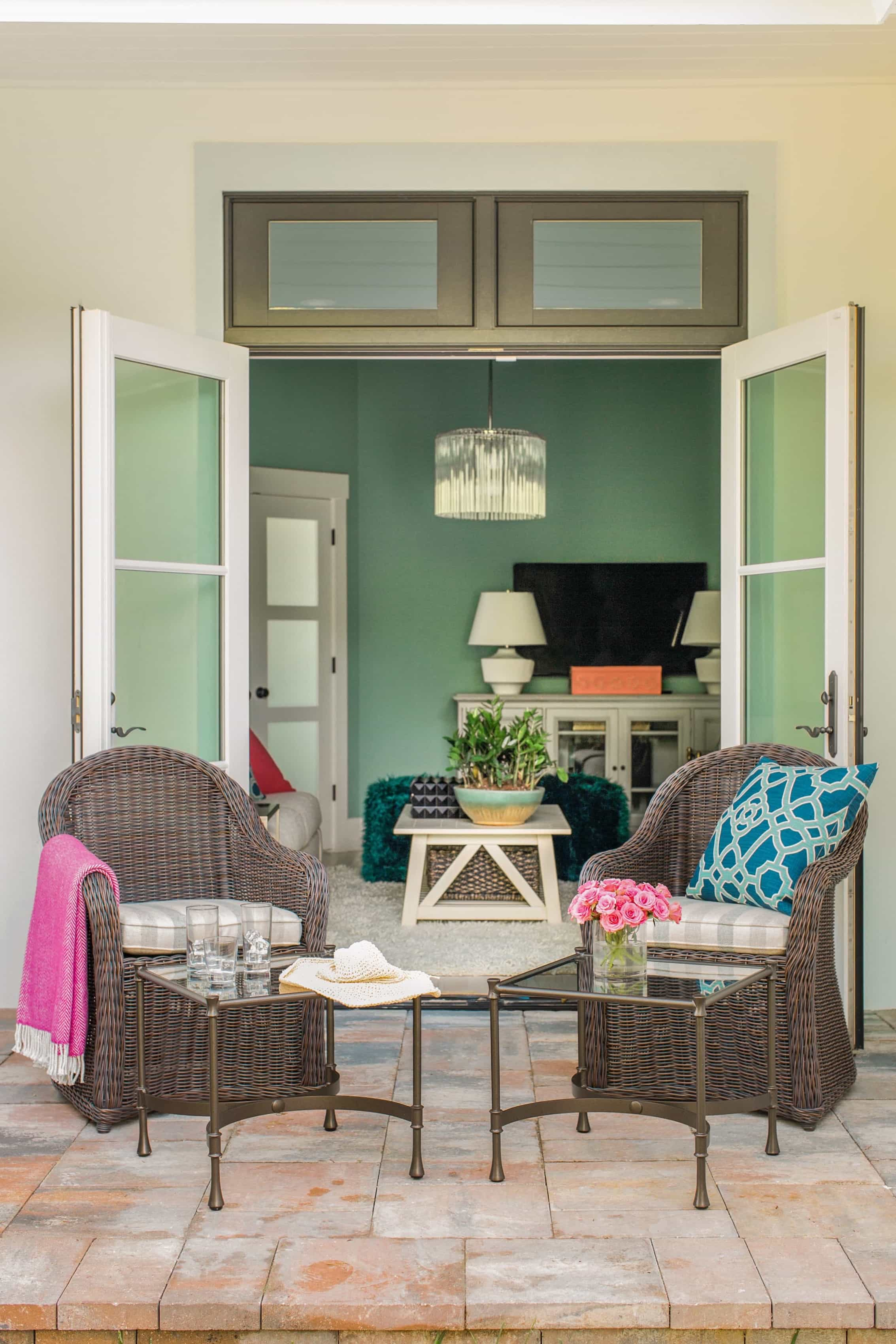 Featured Image of French Doors Open The Media Room Up To A Side Yard With Seating Area