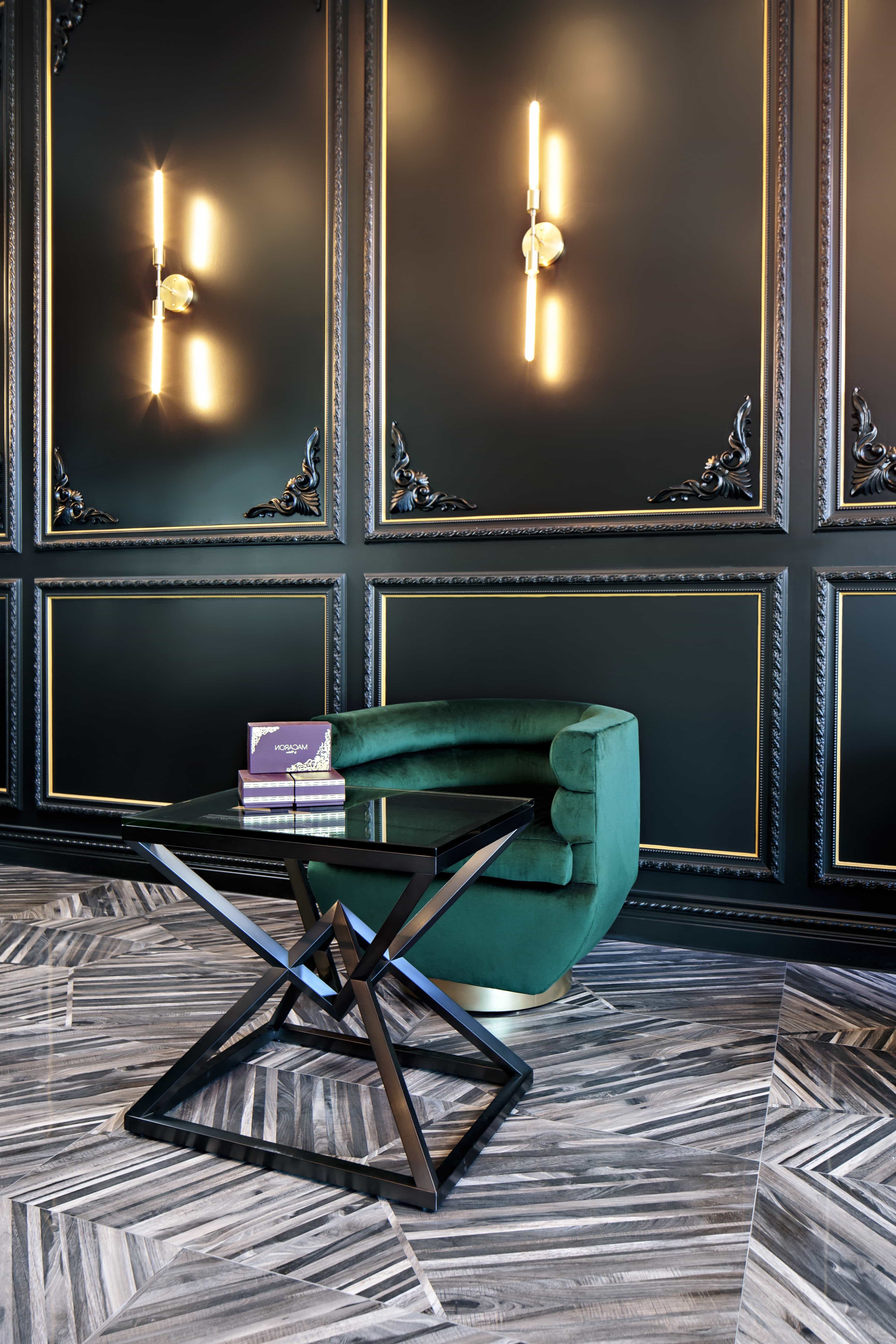 Gothic Sitting Space With Black Wall Panelling And Prism Coffee