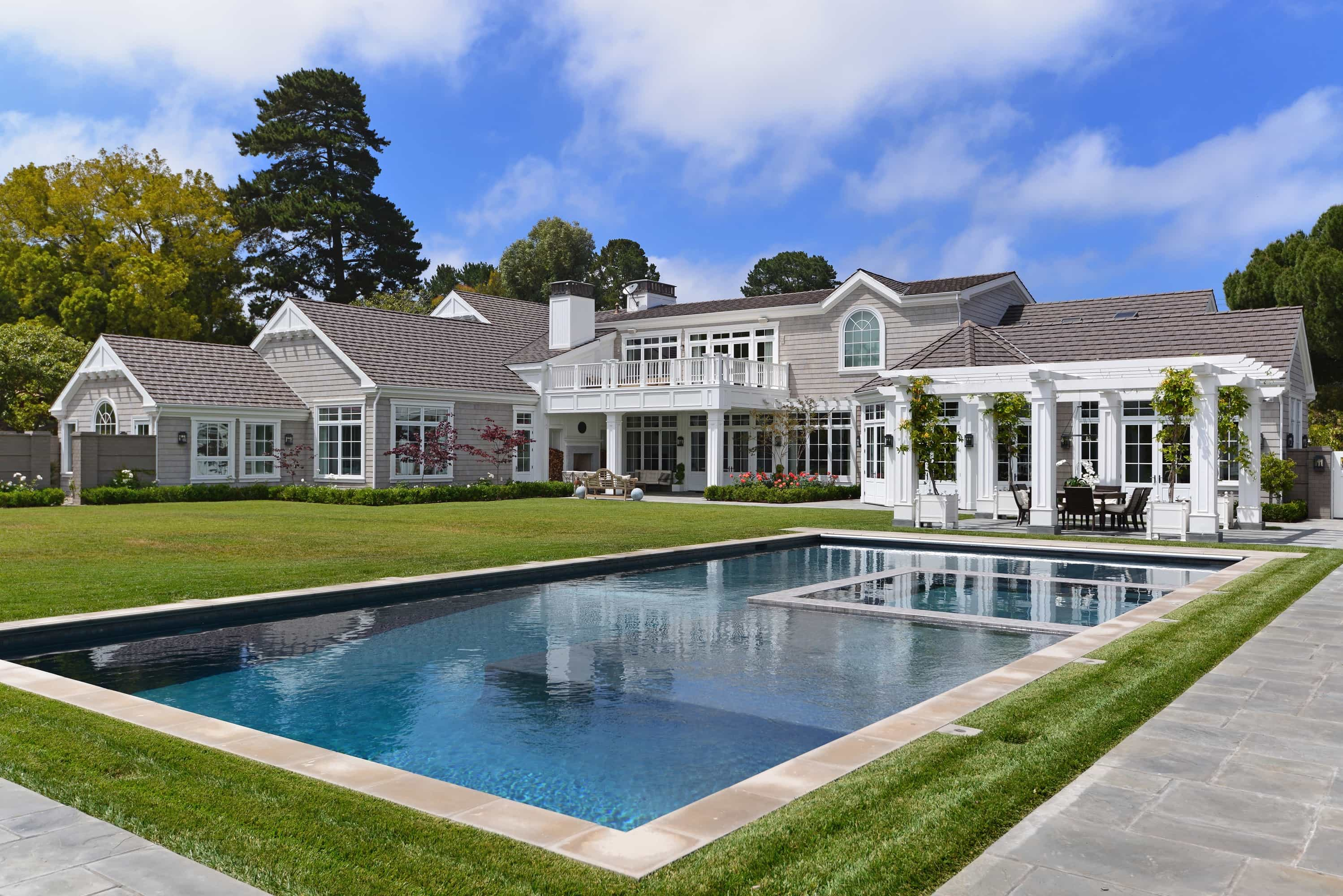 Featured Image of Gray Cape Cod With Manicured Backyard And Pool