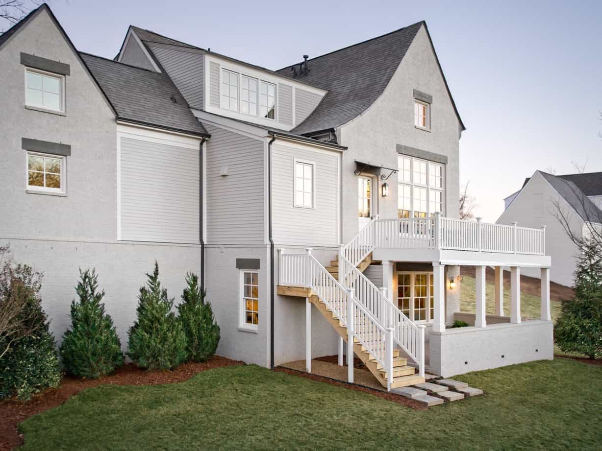 Gray And White Home Exterior With Second Floor Deck