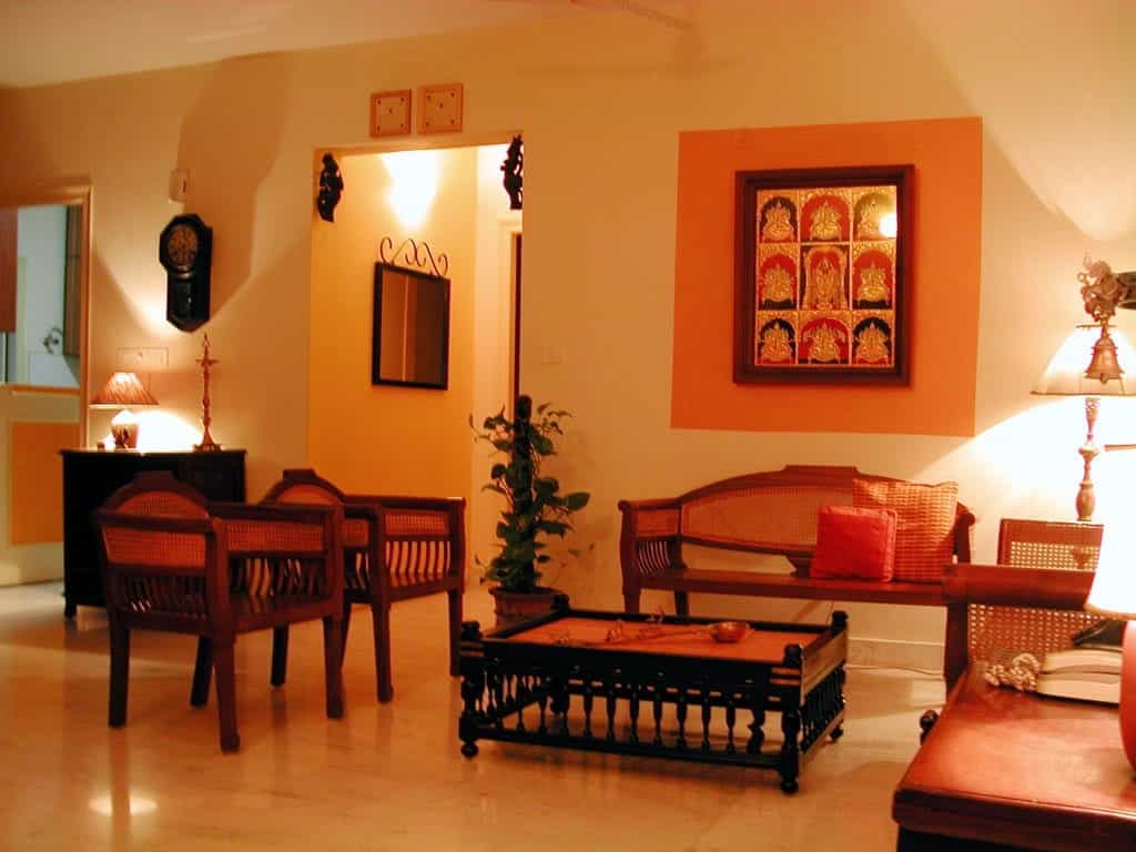 Indian living room with traditional wooden furniture for Ethnic home designs
