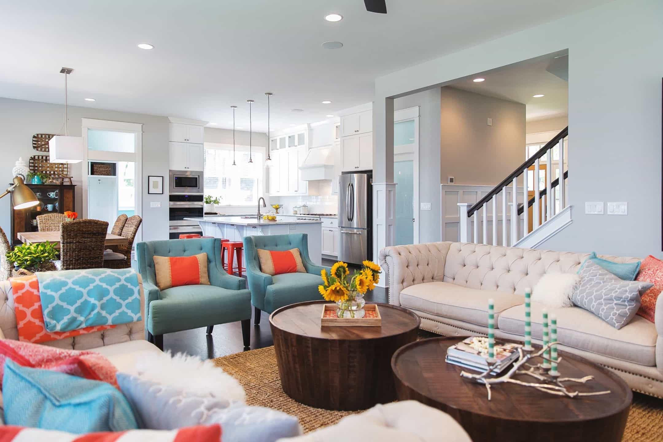 Featured Image of Living Room Features Beige Sofa And Turquoise Armchairs