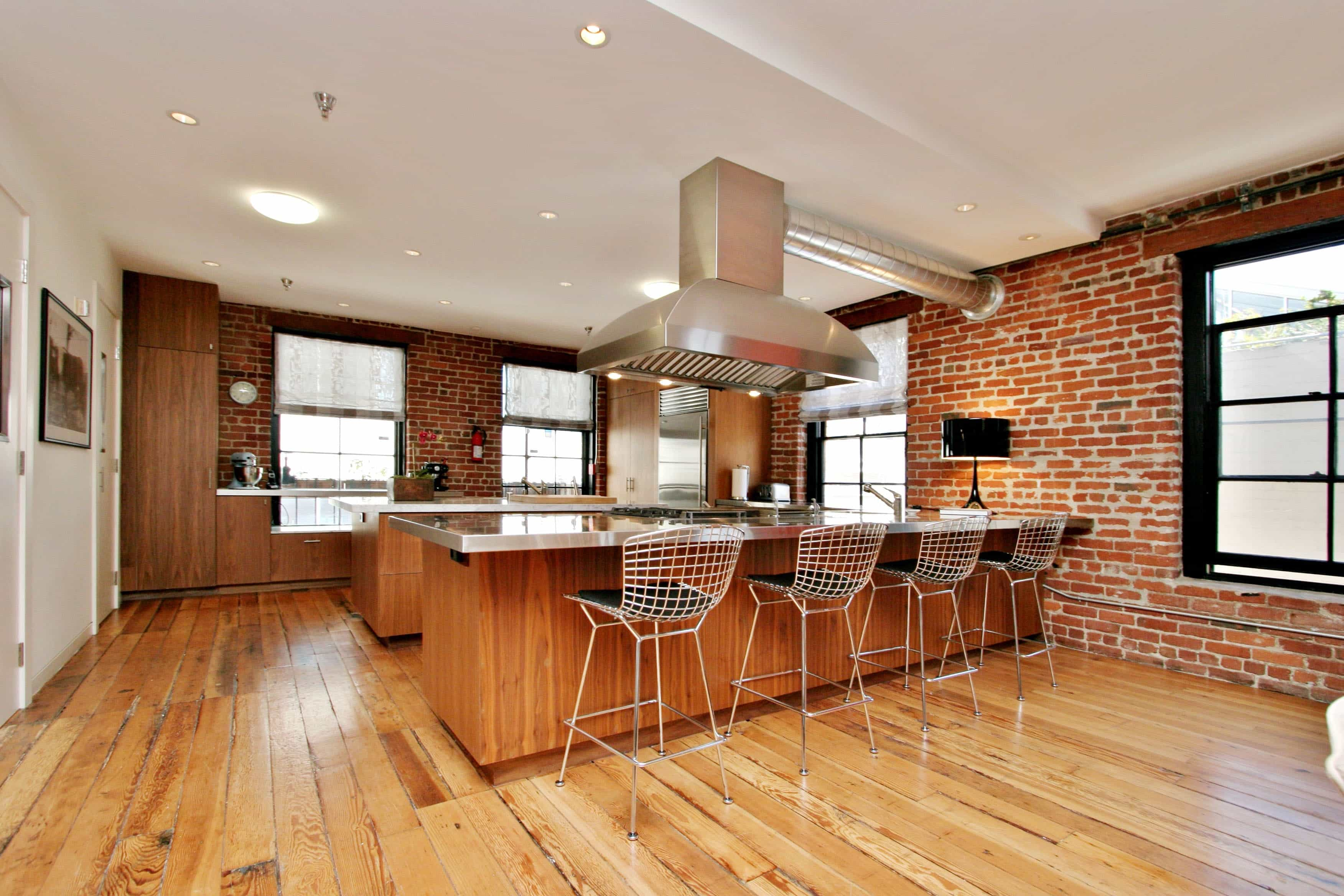 Loft Kitchen With Exposed Brick Walls And Hardwood Floors (Image 14 of 30)