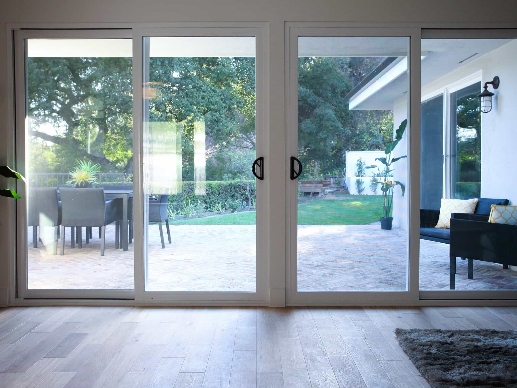 Minimalist Glass Sliding Doors Looks Out To Terrace (Image 13 of 27)