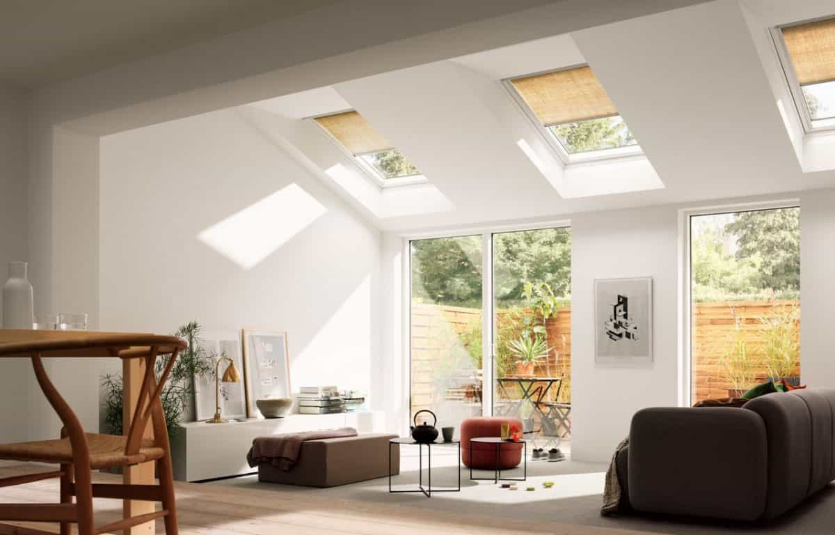 Minimalist Living Room With Large Glass Windows And Skylight Shades (View 2 of 25)
