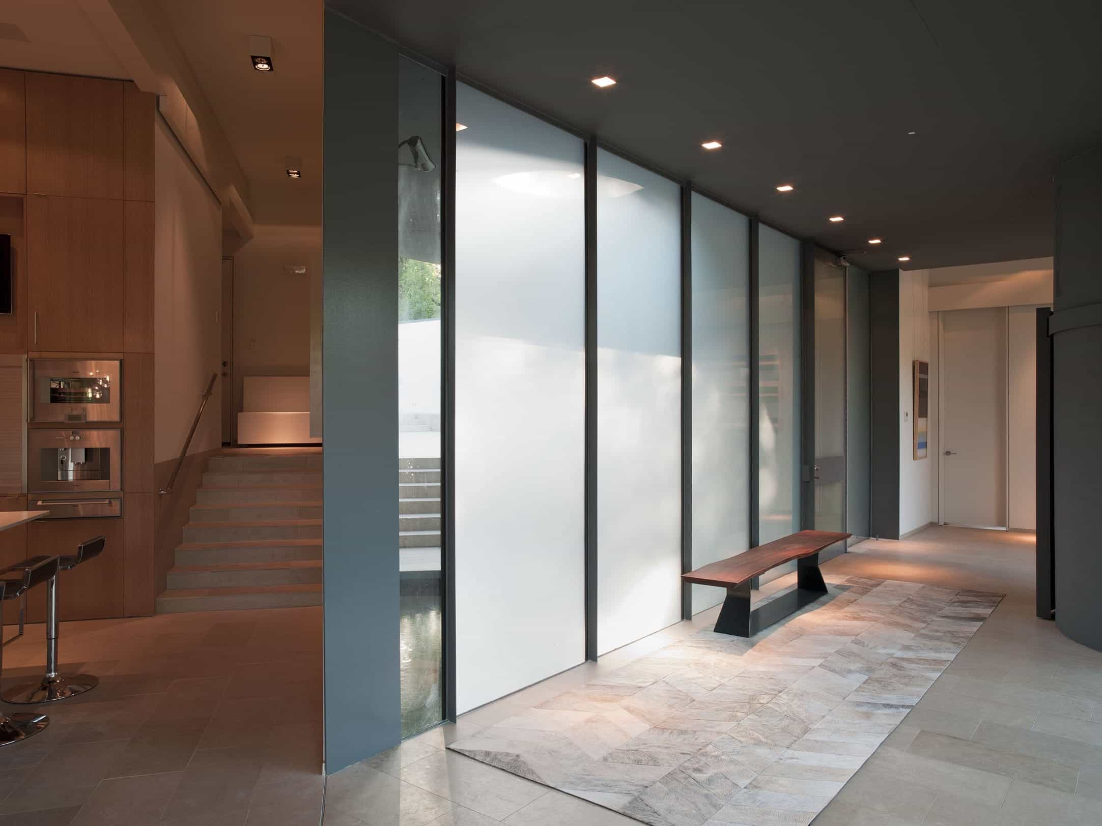 Modern Charcoal Gray Hall With Frosted Sliding Glass Panels (Image 15 of 27)