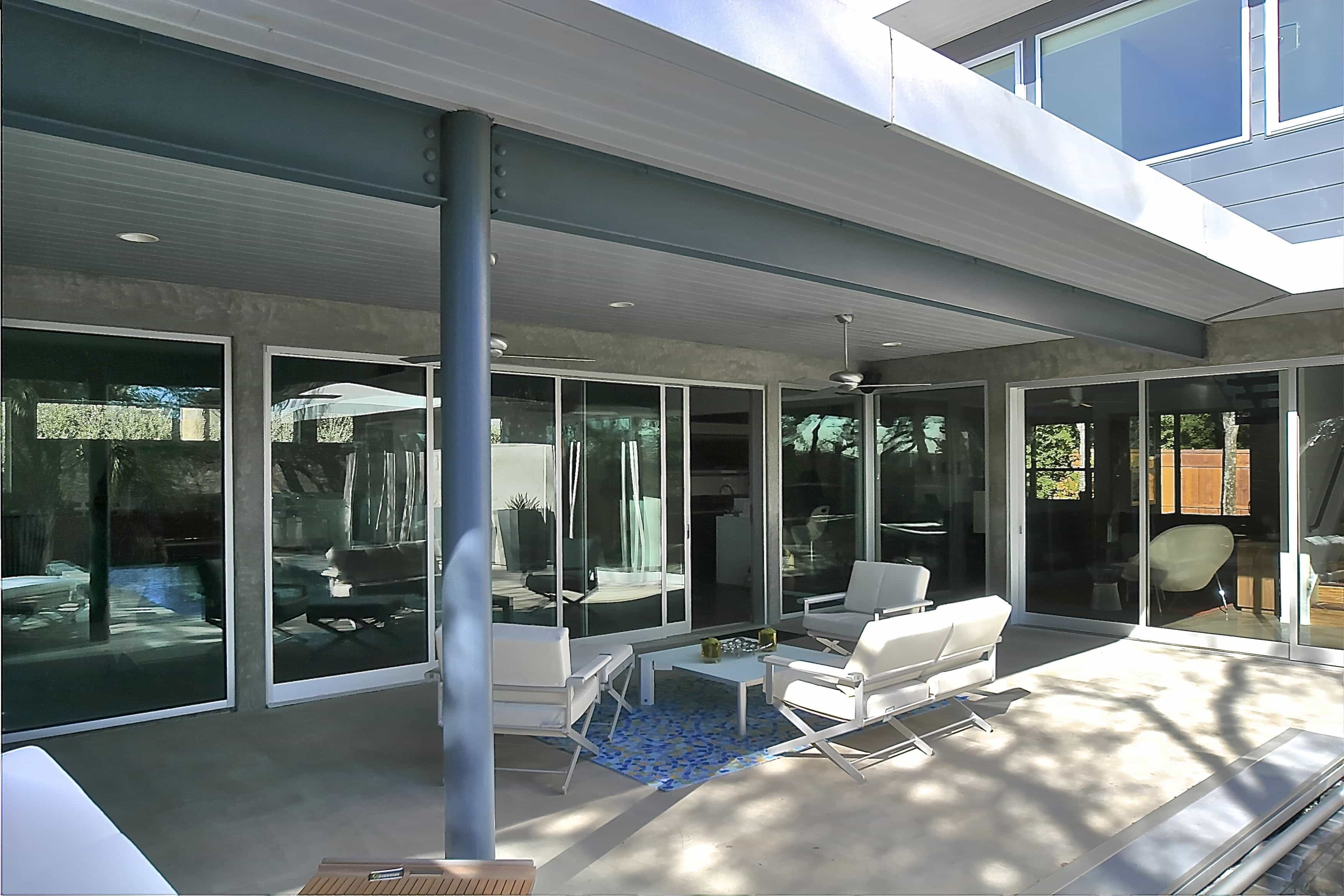 Modern Covered Patio Surrounded By Sliding Glass Doors (Image 16 of 27)
