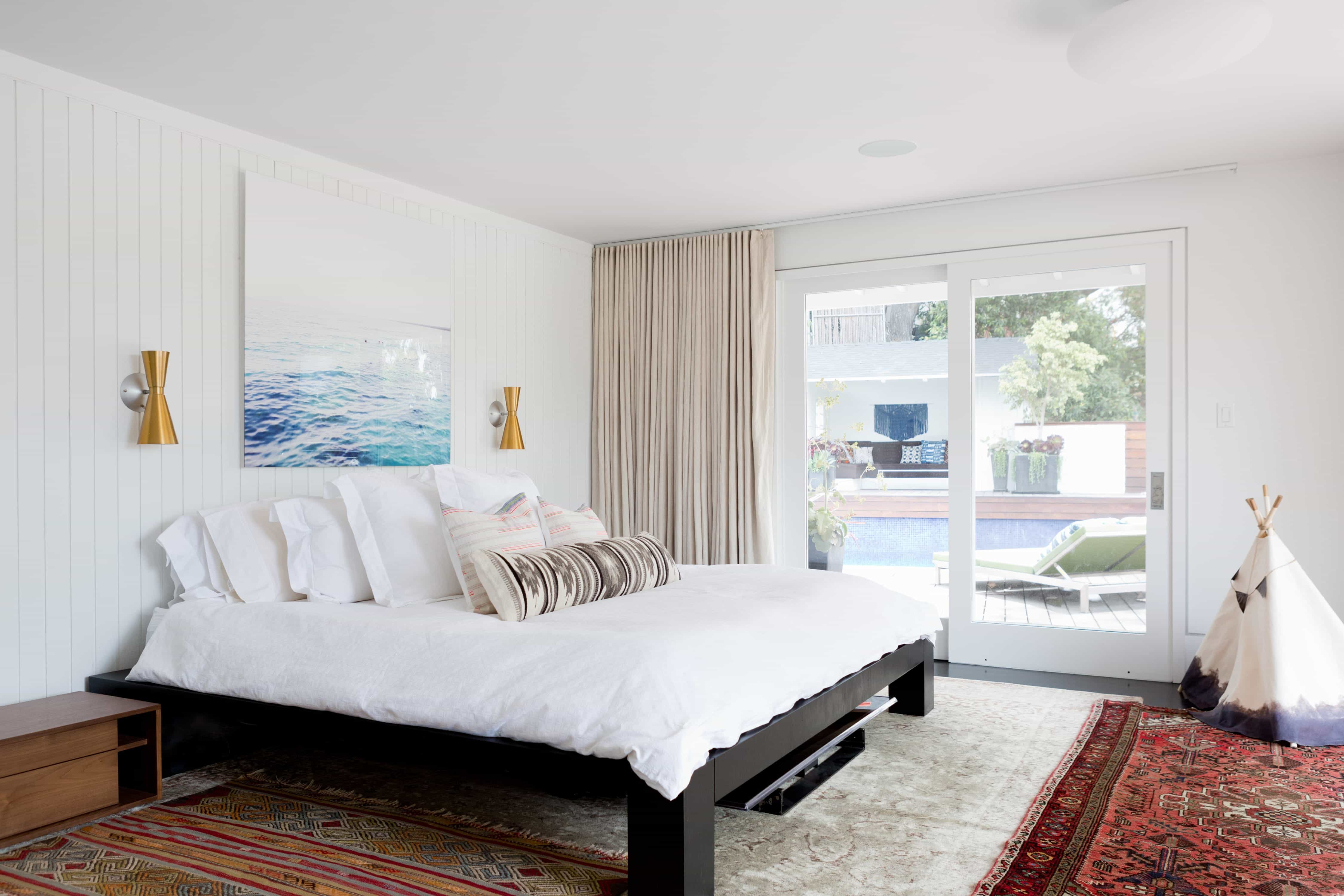 Modern Master Bedroom With Colorful Patterned Rugs And Sliding Glass Door With Curtain (Image 19 of 27)